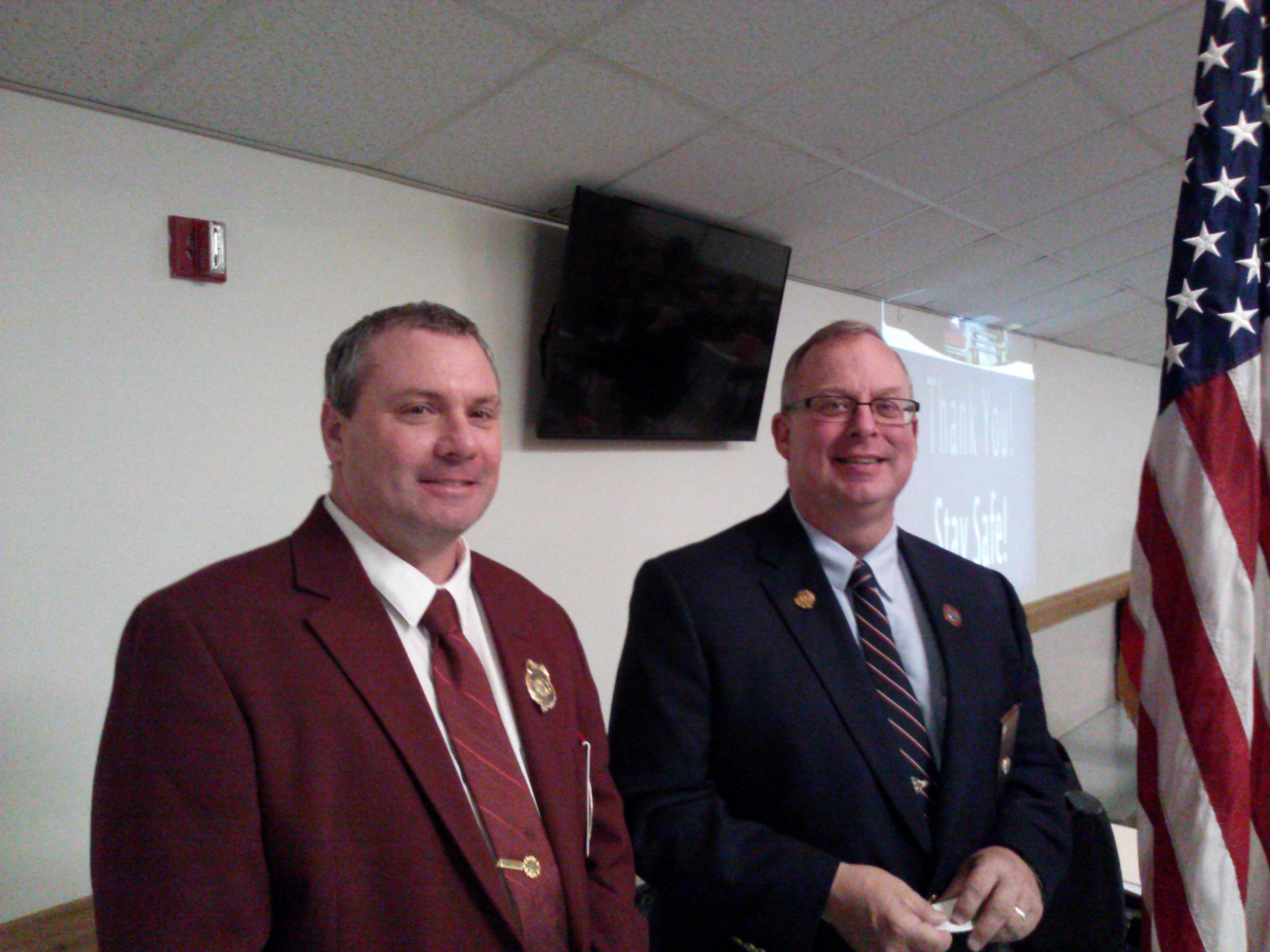 Bruce Mack (left), chief of Frontier Fire Dept., and Robin Schott of the Firemen's Association of the State of New York. (Matt Glynn/Buffalo News)