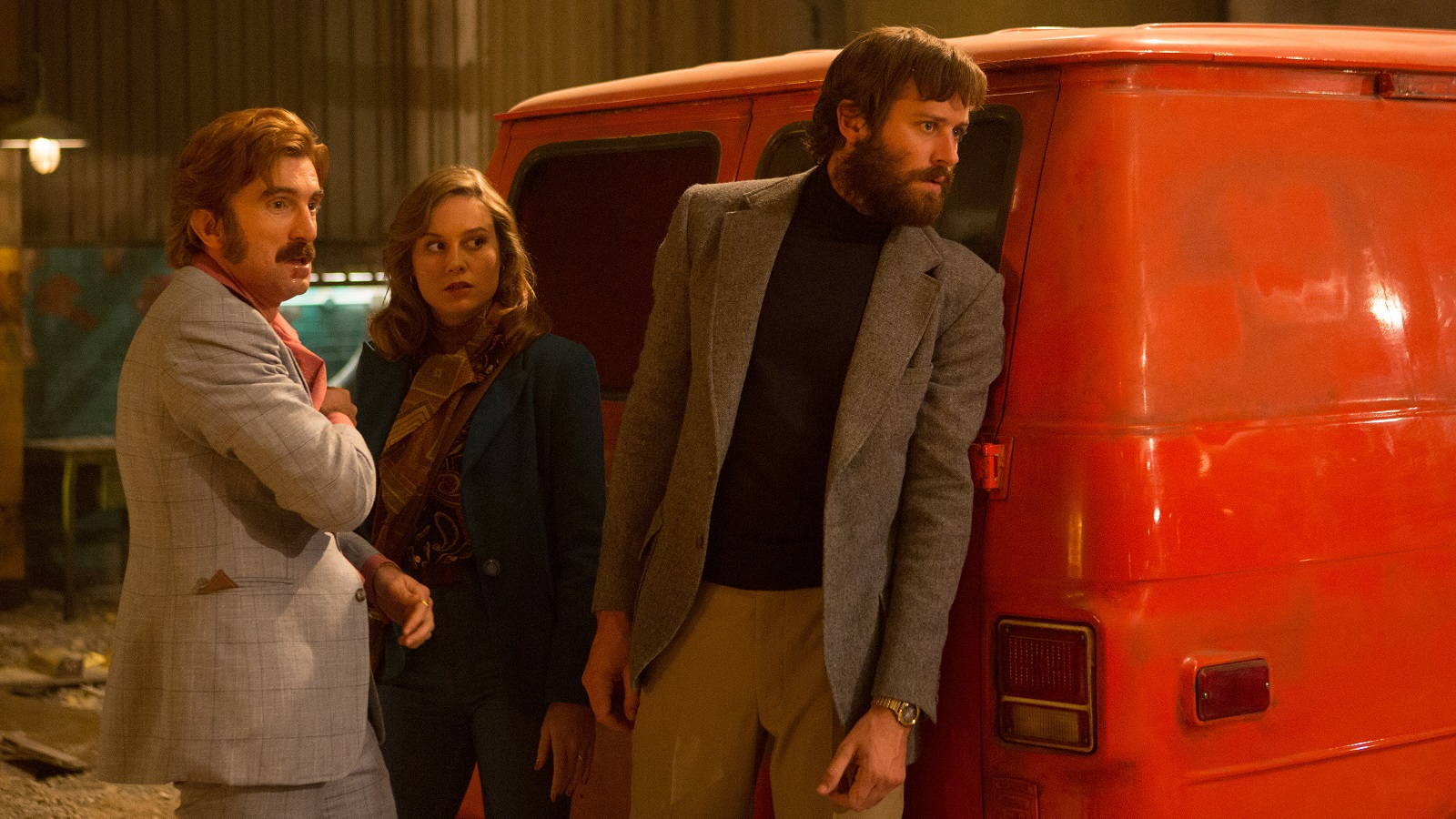 "Sharlto Copley, left Brie Larson and Armie Hammer star in ""Free Fire."""