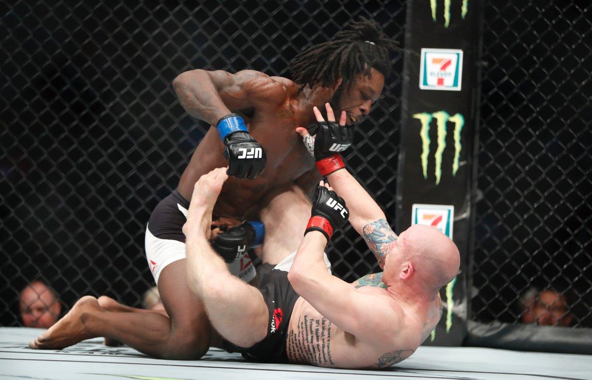 Desmond Green unloads on Josh Emmett en route to winning in his UFC debut in a lightweight bout at KeyBank Center. (Harry Scull Jr./Buffalo News)