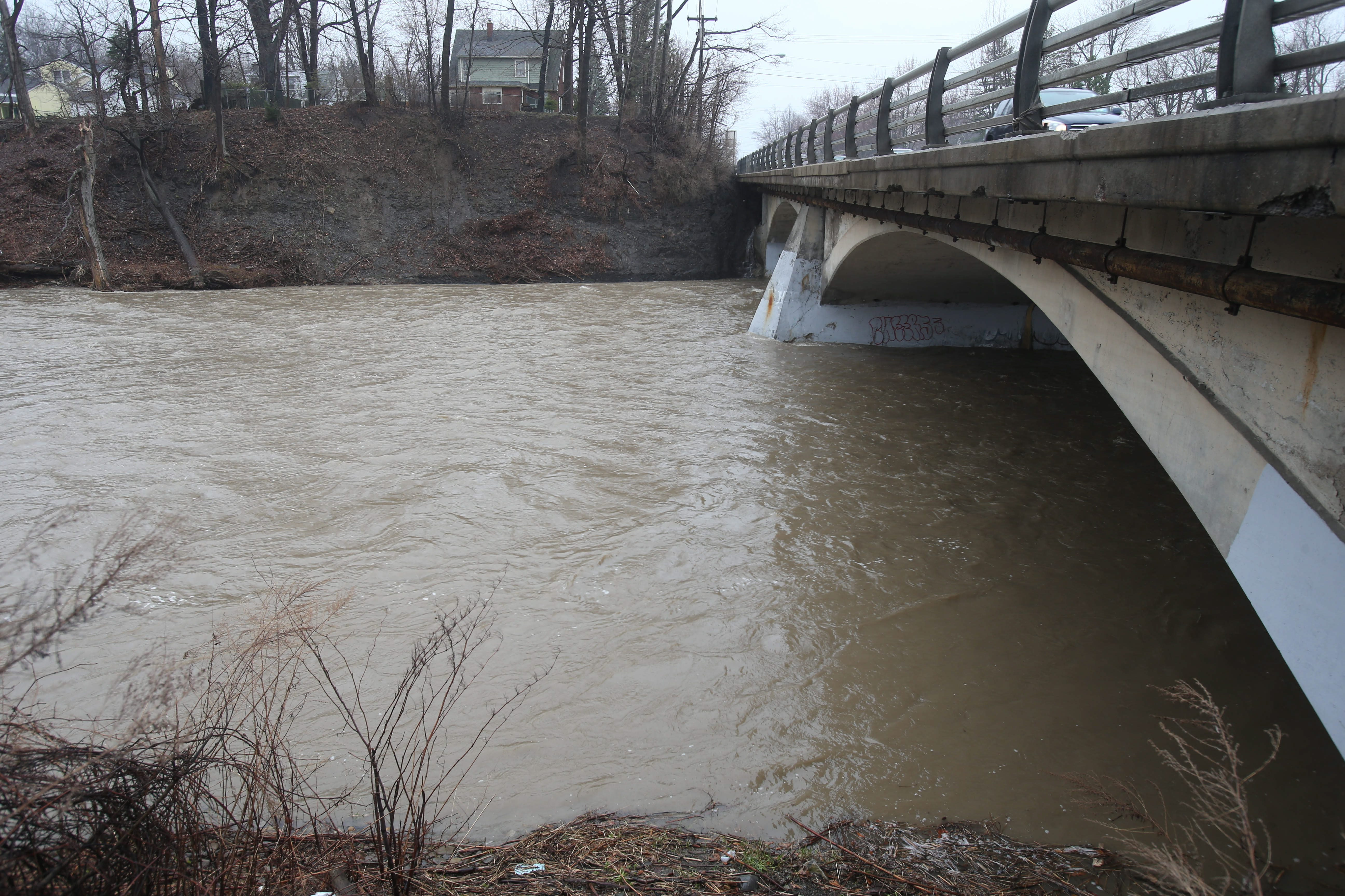 Cazenovia Creek rushes below a bridge on Union Road in West Seneca. (Robert Kirkham/News file photo)