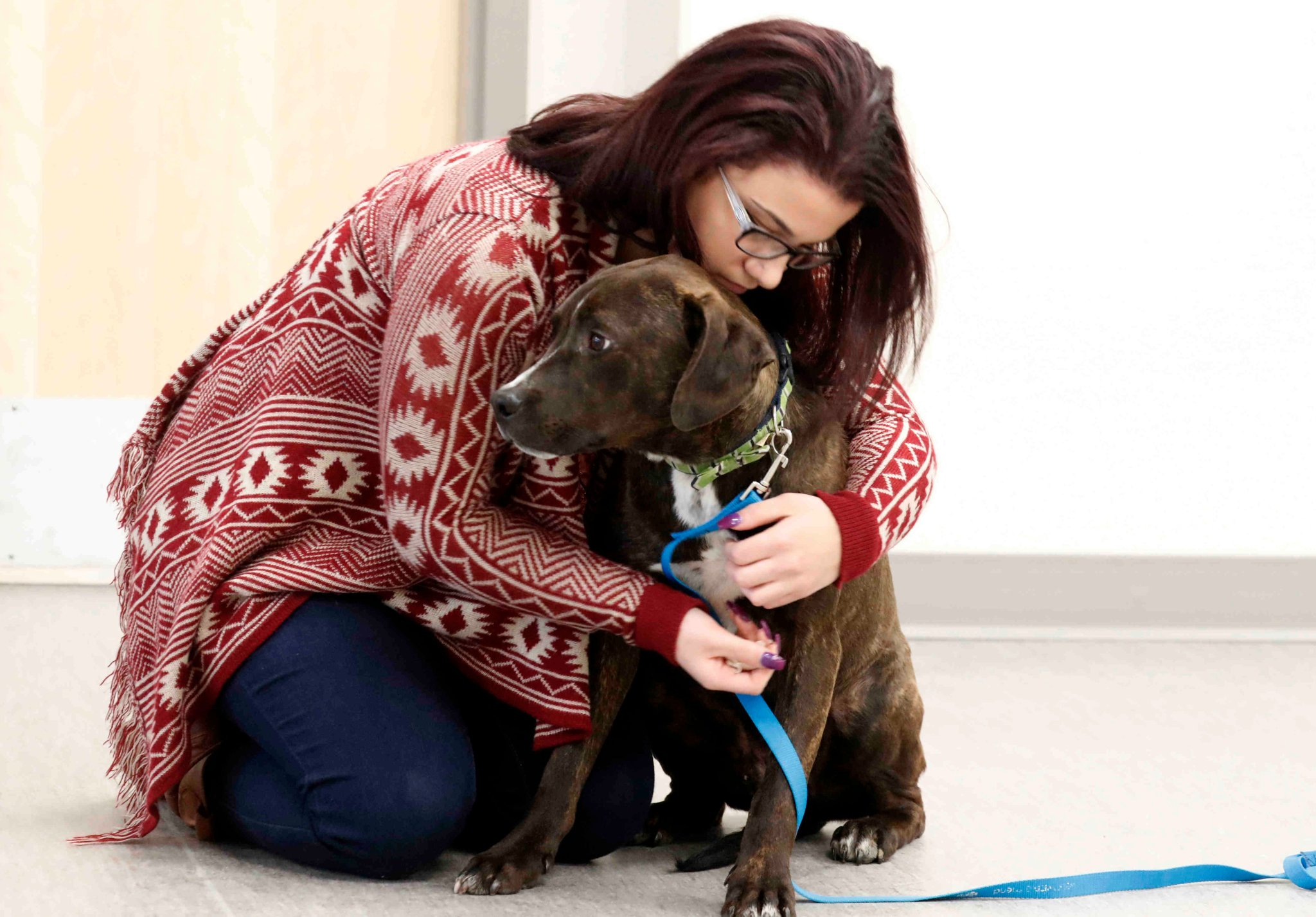 Mercedes Castillo is adopting Jed, the dog she trained while an inmate in Erie County Correctional Facility under Pups at the Pen program. (John Hickey/Buffalo News)