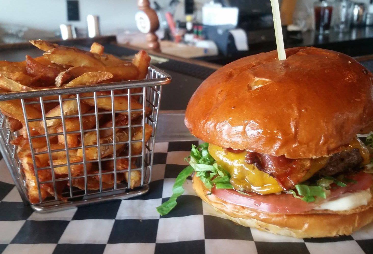The 'Divine Swine' burger and fries at Juicy Burger Bar. (Juicy Burger Bar)