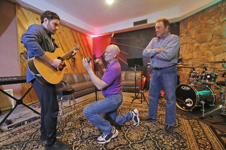 Venue owner Charles  Anderson, right, checks on a recording session with guitarist Max Muscato as  audio engineer Mike Rorick adjusts a mic in the recording studio. Anderson plans to add a live music room to the Military Road facility.  (Robert Kirkham/Buffalo News)
