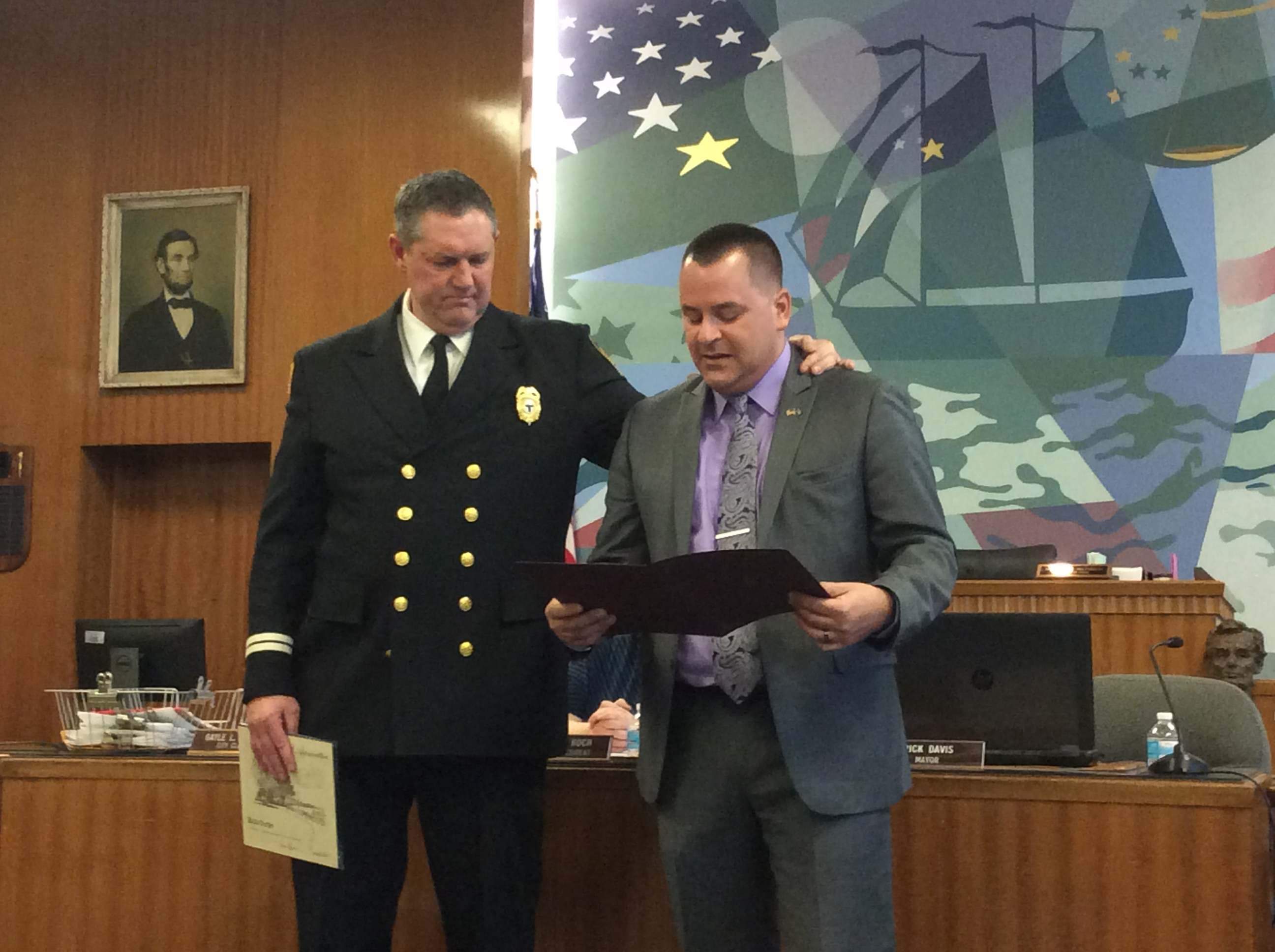 Volunteer firefighter Rick Oates is honored for his service by City of Tonawanda Mayor Rick Davis.