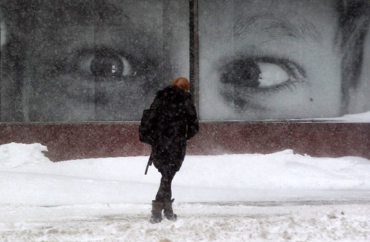 Beware the eyes of March. A pedestrian makes their way through the snow and wind on Franklin Street in Buffalo on a record-breaking day for snowfall, March 15. (Mark Mulville/Buffalo News)