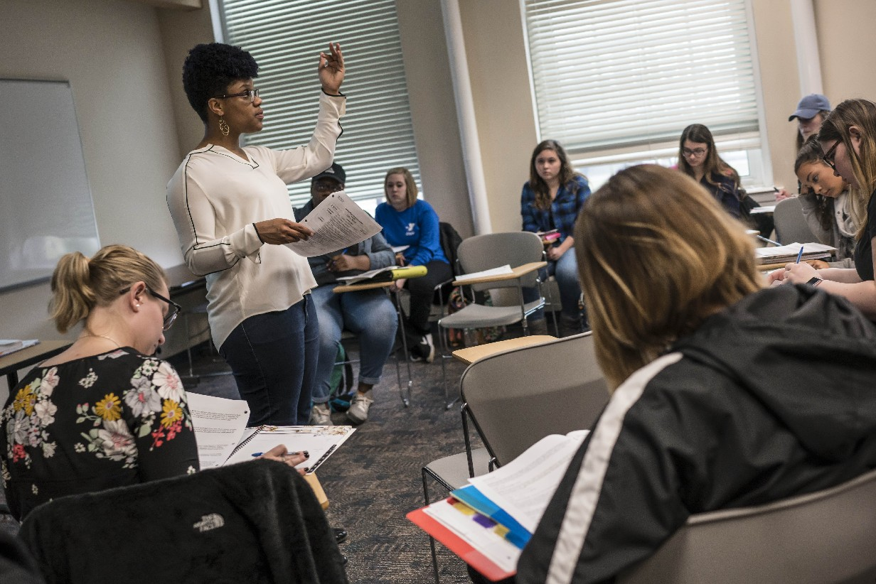 "Tiffany M. Nyachae, a Buffalo Public Schools graduate, teaches a ""School and Society"" class at SUNY Buffalo State. A new program aims to diversify the teaching ranks by encouraging more city students to pursue the profession. (Derek Gee/Buffalo News)"