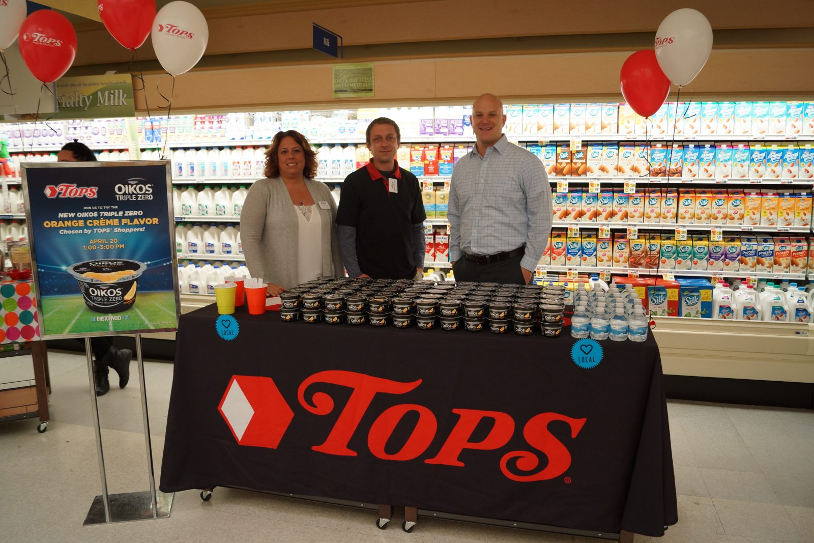 Kris Ponzi, Store Manager; and Mario Monte, Dairy/Frozen Manager,; both from Tops, at the Elmwood Avenue store. Matthew P. Geiger, Key Account Manager, Danone North America. (Contributed photo)