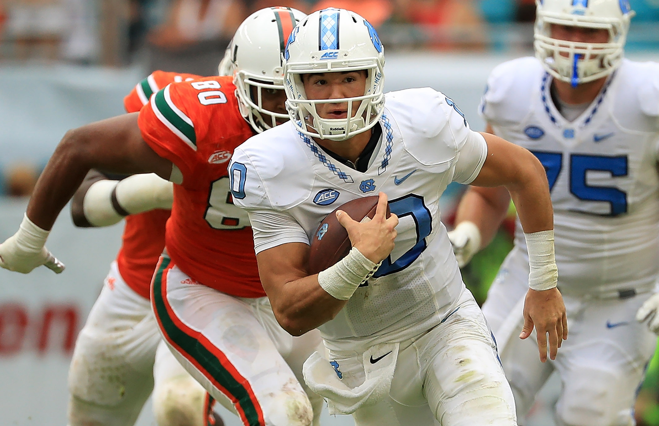 Mobility is a big part of what makes North Carolina's Mitchell Trubisky a top quarterback prospect.  (Photo by Mike Ehrmann/Getty Images)