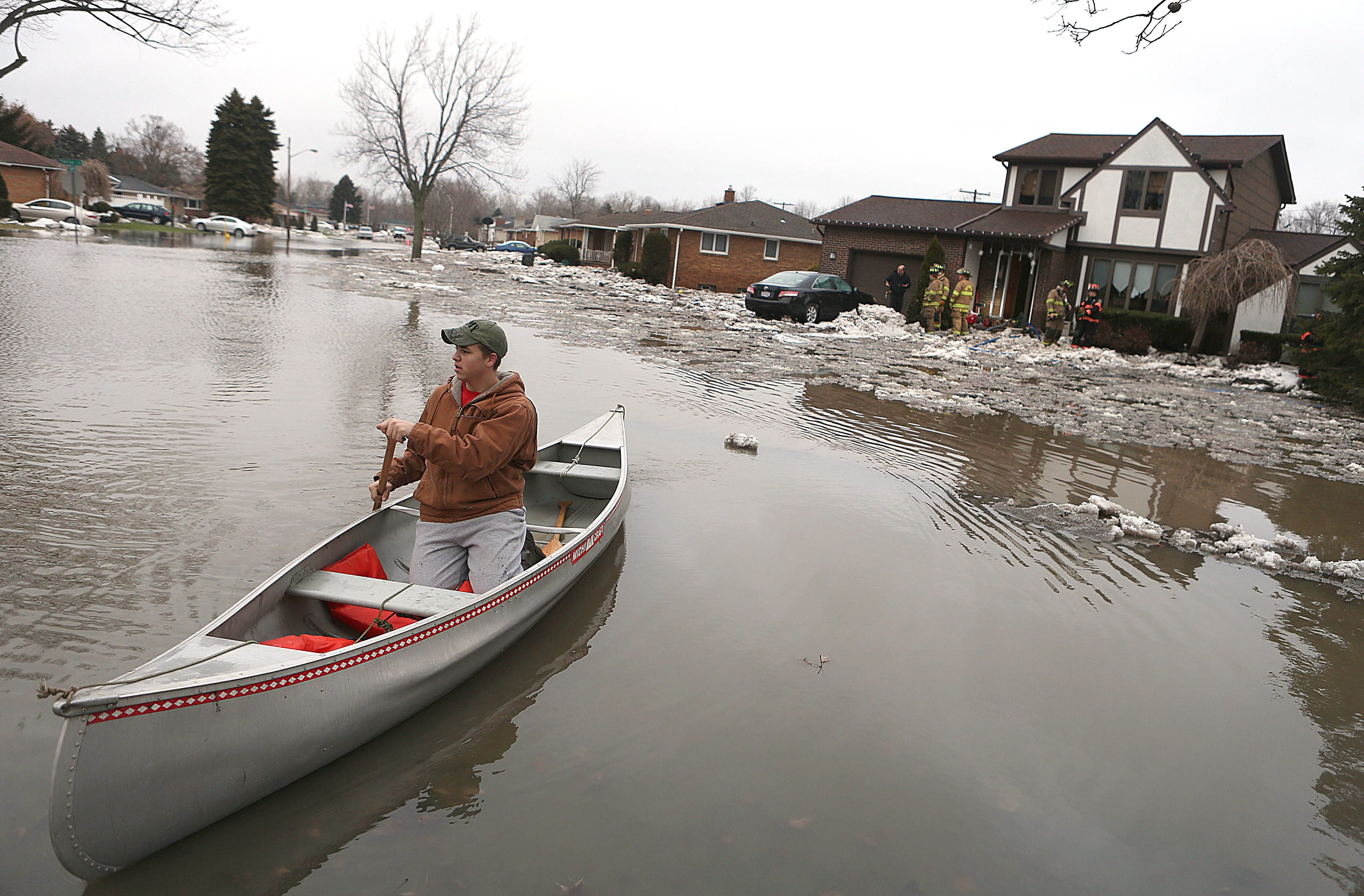 Ben Lang, of Elma, paddles a canoe down Brian Lane in West Seneca during a high water event in January 2014. Flooding devastated neighborhoods near Buffalo Creek including Lexington Green off Mineral Springs. This week's event won't involve ice-jam flooding, however, record-breaking rainfall is forecast on Thursday. (Robert Kirkham/Buffalo News)