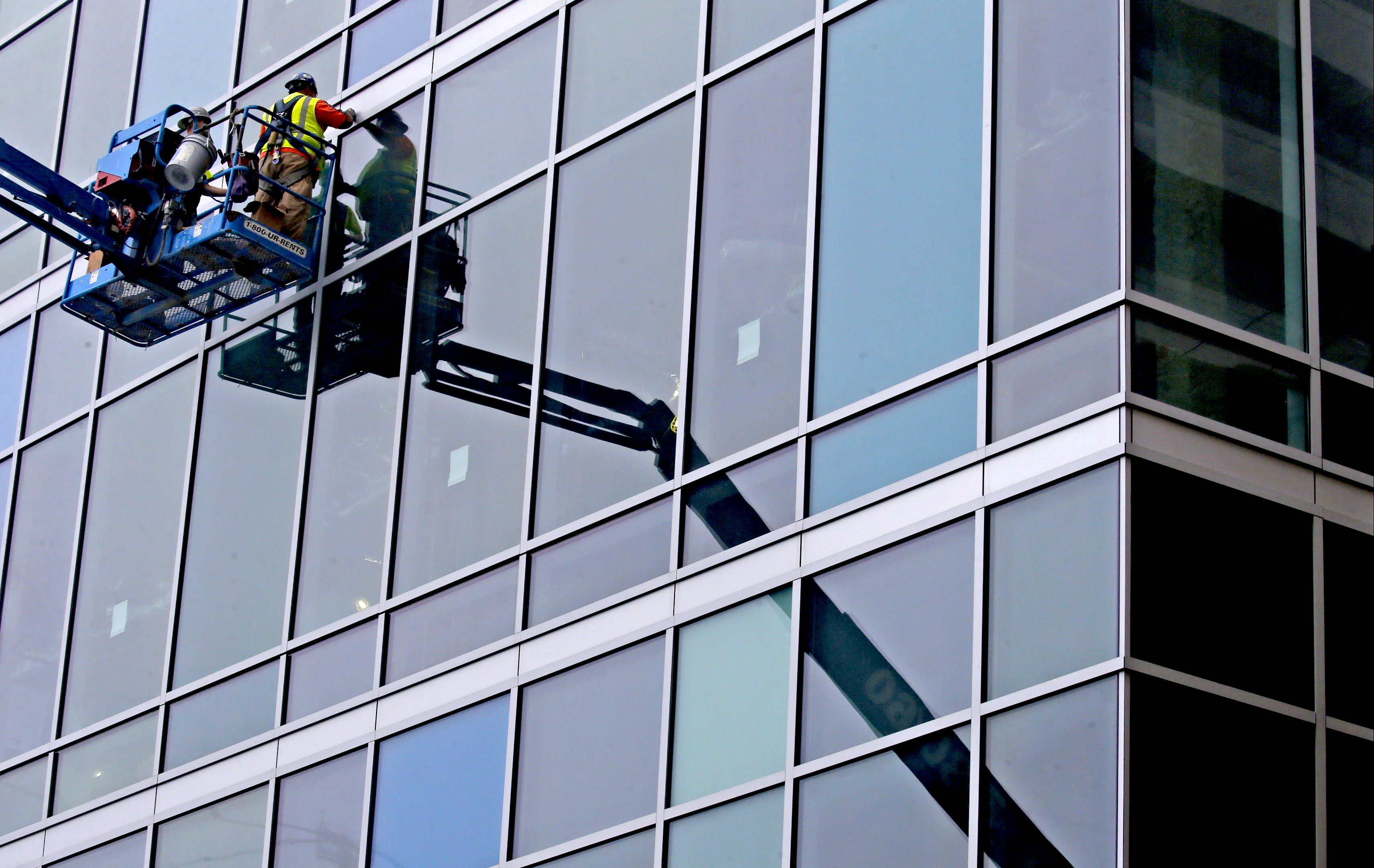 Workers adjust the windows during installation at the John R. Oishei Children's Hospital   in Buffalo in this 2016 file photo.  (Robert Kirkham/Buffalo News)