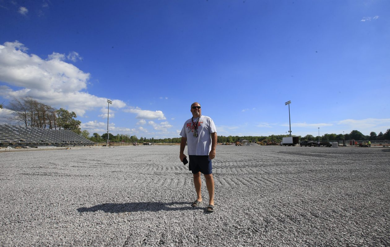 Mark Layer, looking over the construction of the all-weather field at Clarence last summer stepped down as coach of the Red Devils after 30 years with the prorgram . (Harry Scull Jr./Buffalo News)
