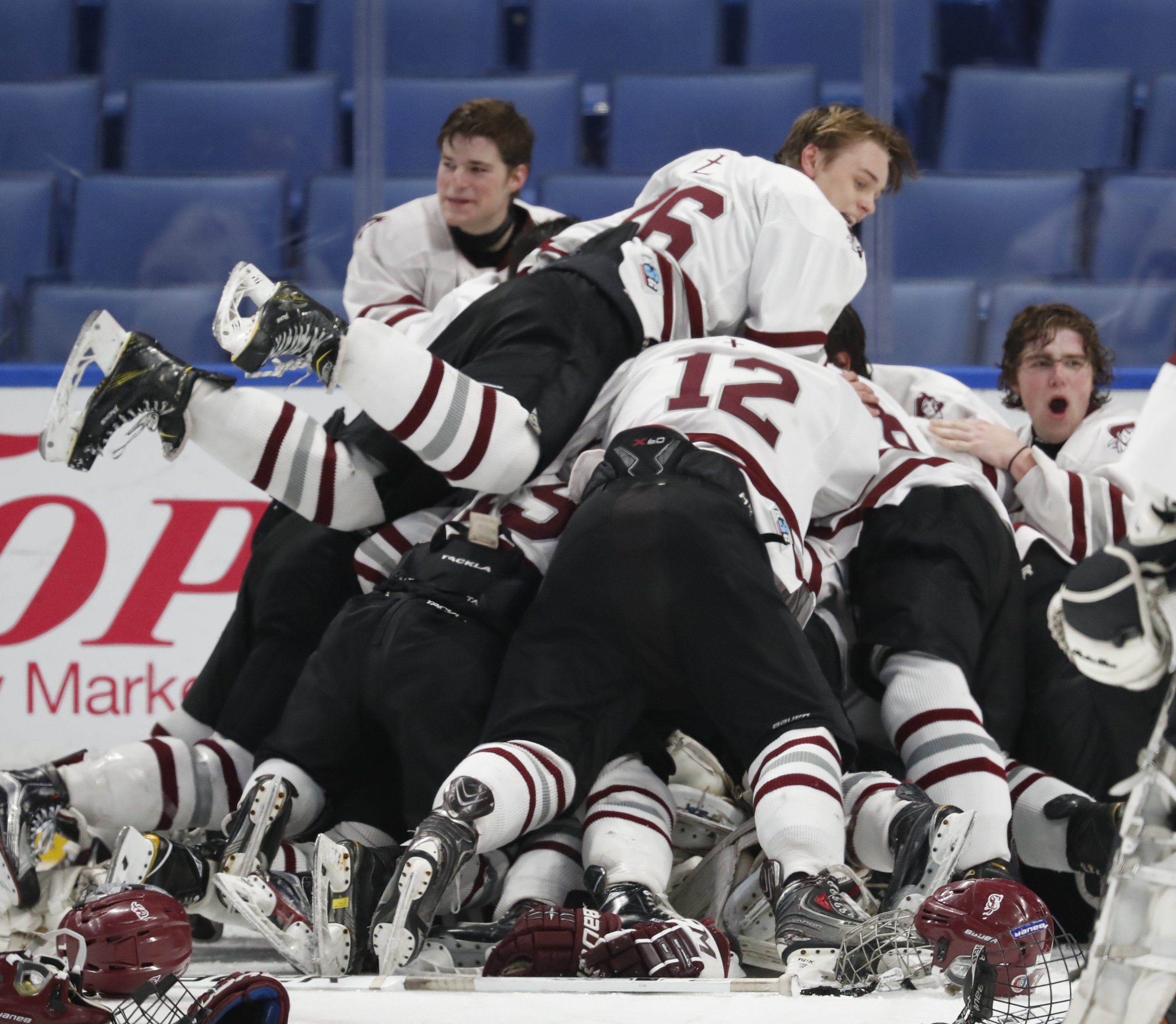 St. Joe's Trevor Conschafter jumps on the victory pile after the Marauders captured the Niagara Cup en route to the state Catholic championship and season-ending 22-game unbeaten streak.  (Harry Scull Jr./Buffalo News)