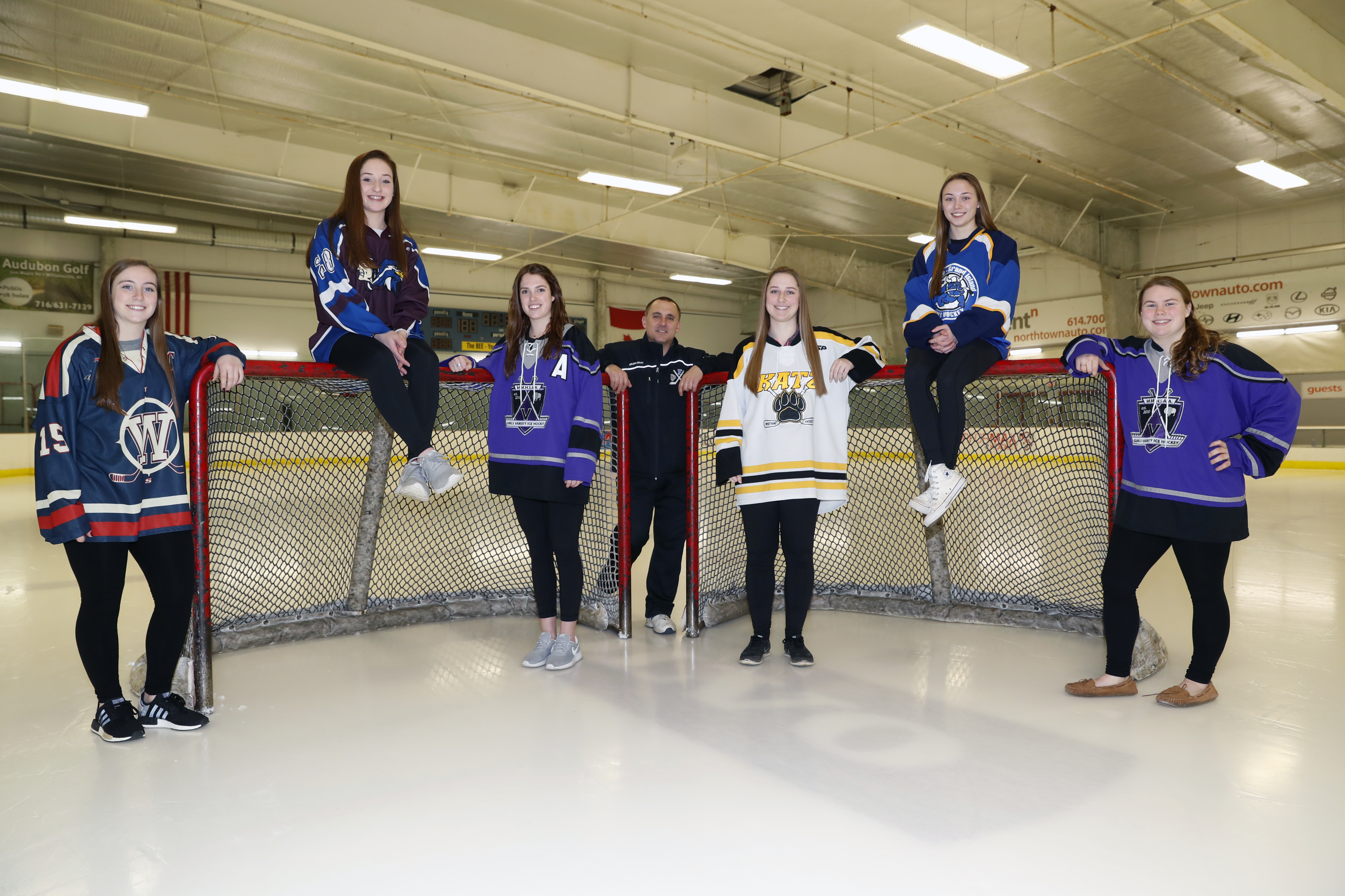 Here is the 2016-17 All-Federation Girls Hockey First Team.  From left, Leah Czerwinski (Williamsville), Brooke Becker (Frontier/Lake Shore/Orchard Park),  Ellie Cleary (Monsignor Martin), Coach of the Year Bob Klimowicz (Frontier/Lake Shore/Orchard Park),  Julia Mings (Clarence/Amherst/Sweet Home), Olivia Smith (Kenmore/Grand Island), Brianna Gawronski (Monsignor Martin). (Harry Scull Jr./Buffalo News)