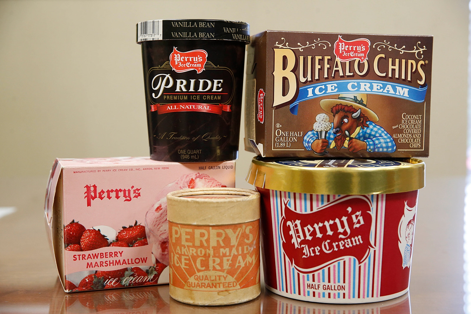 Various styles of Perry's Ice Cream containers from over the years. (Sharon Cantillon/Buffalo News)