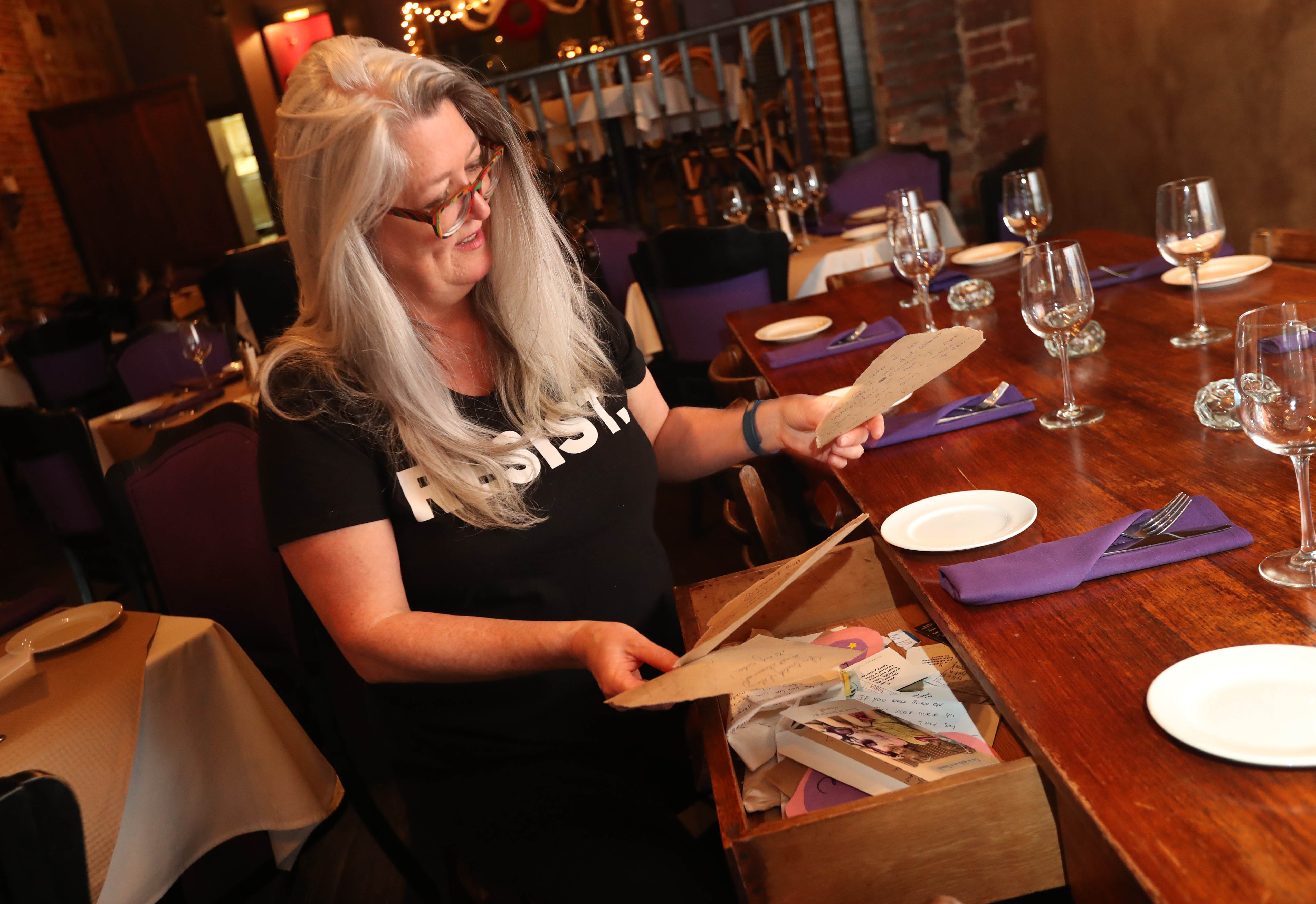 When Coco Bistro at 888 Main St. opened, owner Maura Crawford put in a long table that her brother had used for family gatherings. She began filling its drawers with crazy odds and ends. Now, it's the customers who leave things such as notes and random cards and candy.  (Sharon Cantillon/Buffalo News)