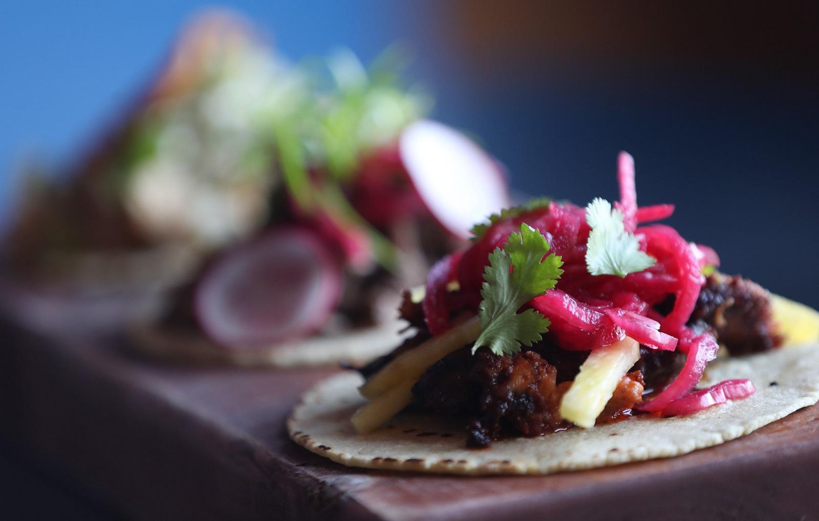 The al pastor taco, front, from Casa Azul. (Sharon Cantillon/Buffalo News)