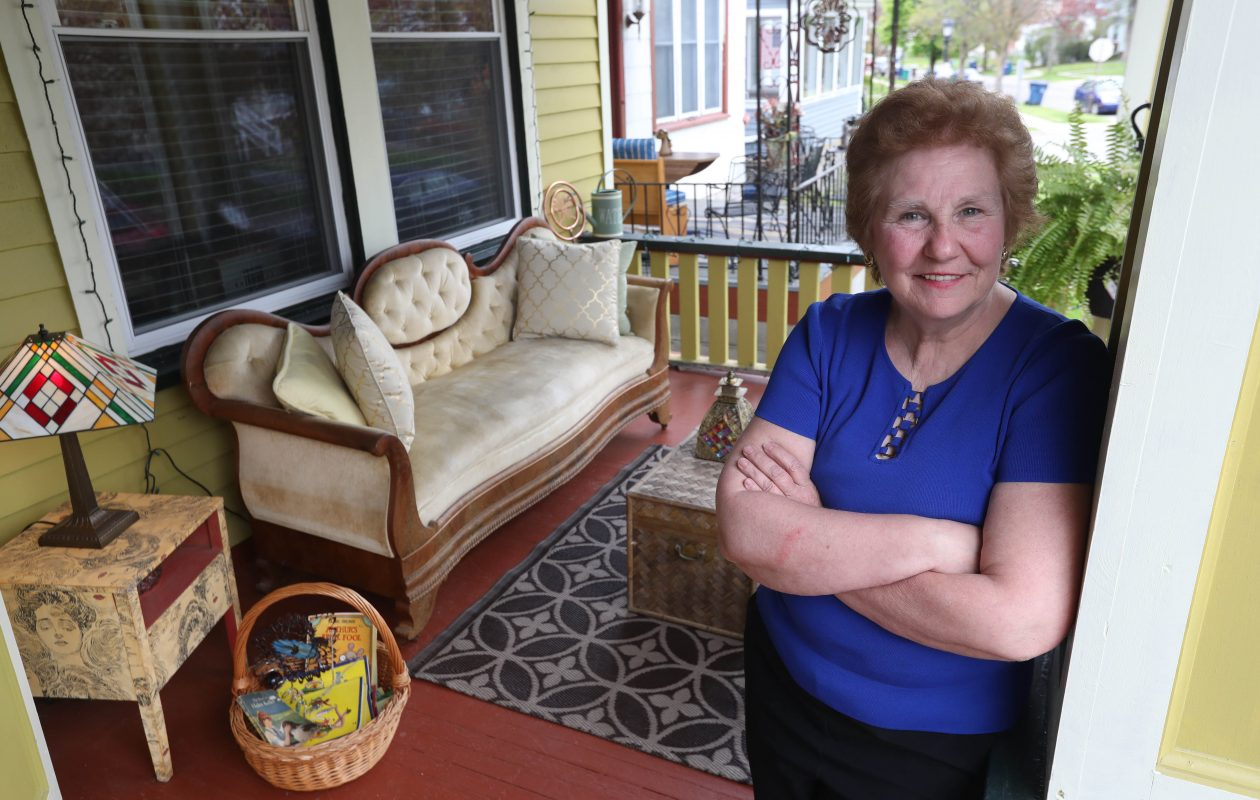 Karen Biel Costantino on the porch of her restored home in the Parkside neighborhood of Buffalo, N.Y. (Sharon Cantillon/Buffalo News)