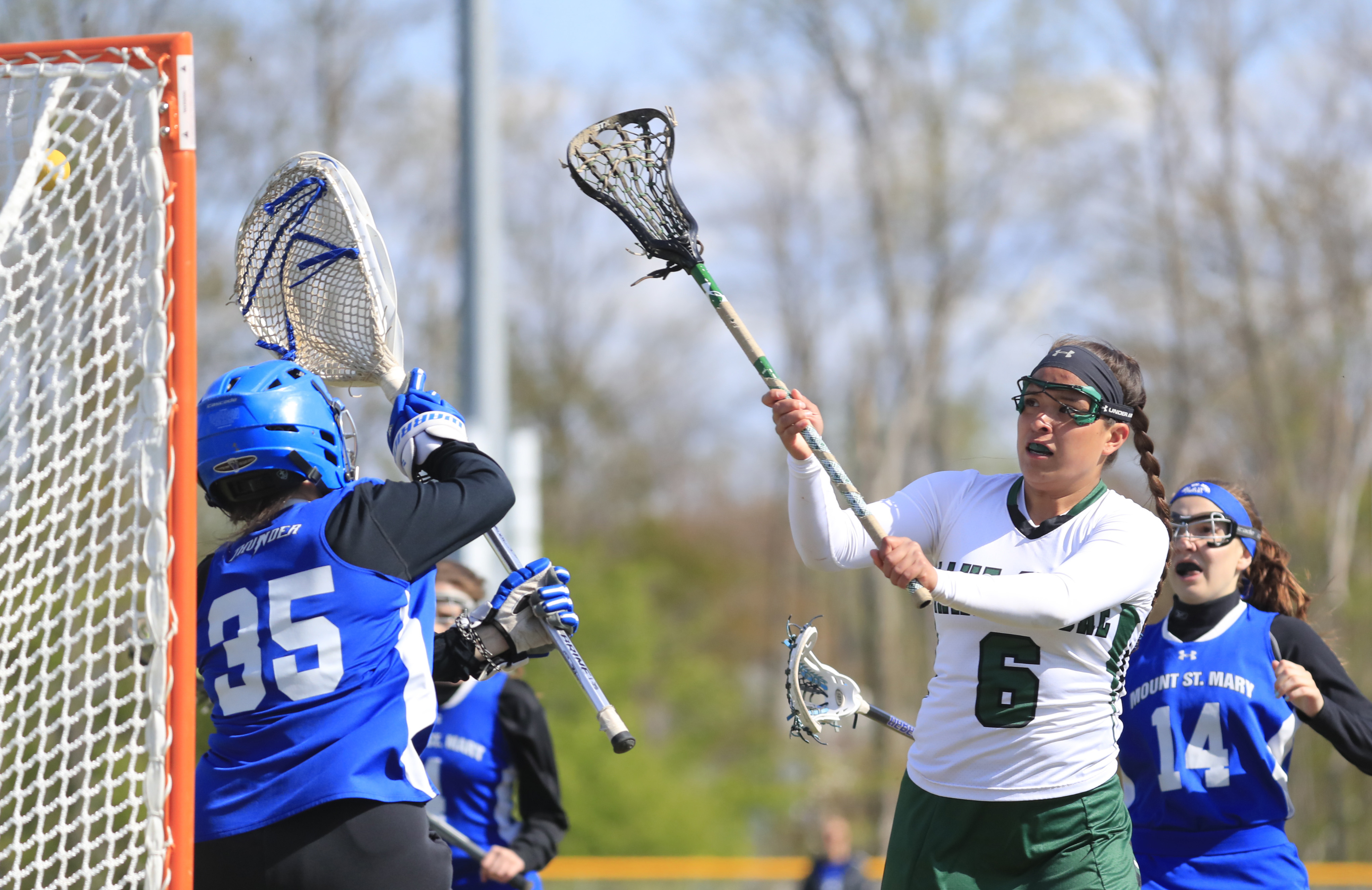 Ivy Santana scores a goal for Lake Shore in its 20-1 girls lacrosse win against Mount St. Mary on Monday. (Harry Scull Jr./Buffalo News)