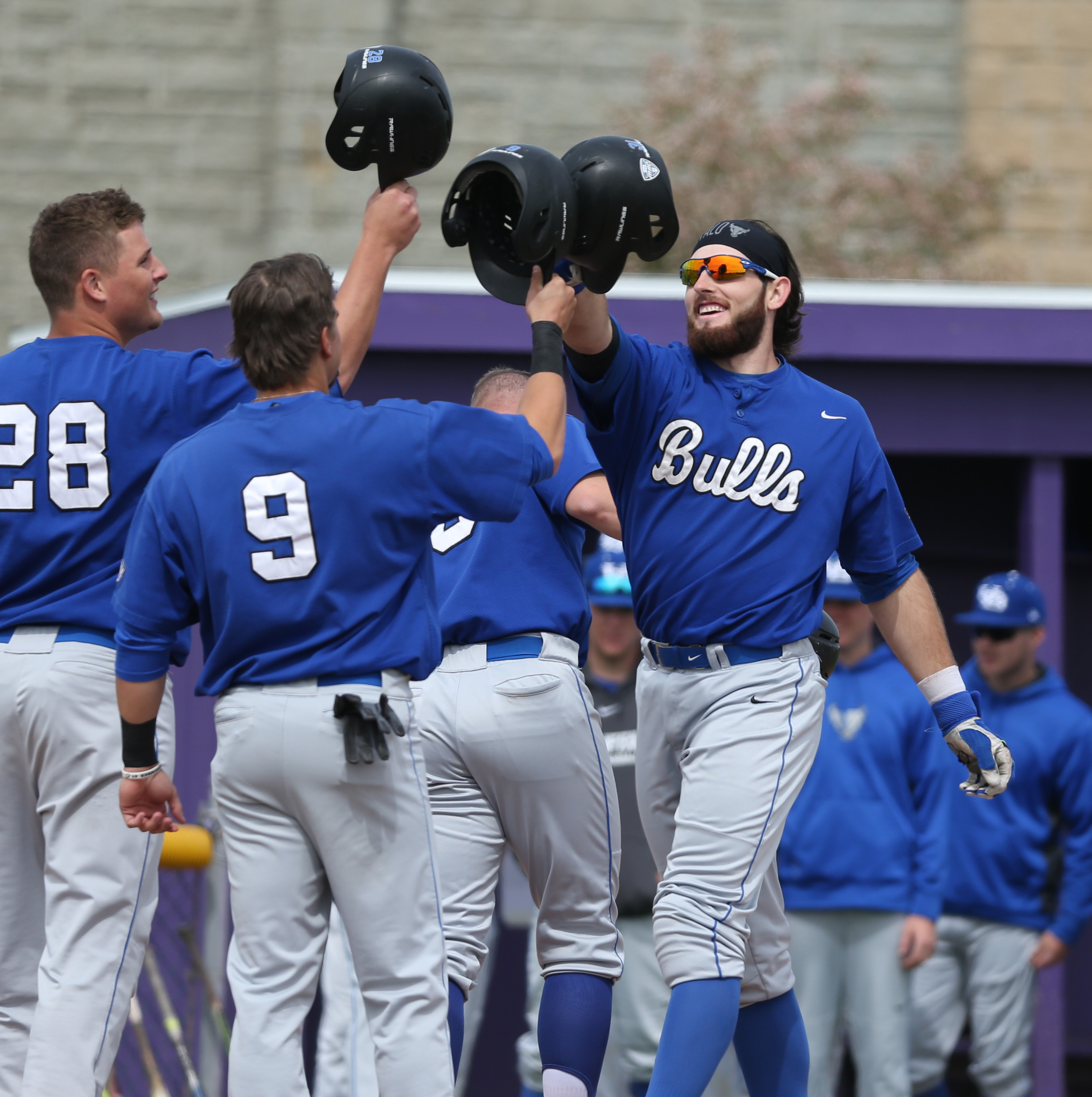 UB's Kyle Brennan is congratulated by his teammates after hitting a grand slam in the first inning at Niagara University. (James P. McCoy/Buffalo News)