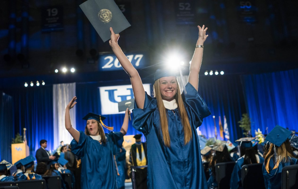 Graduates Emily Paap, right, and Jane Truesdell, left, celebrate after walking across the floor during the University at Buffalo commencement in Alumni Arena, Sunday, May 21, 2017.  (Derek Gee/Buffalo News)
