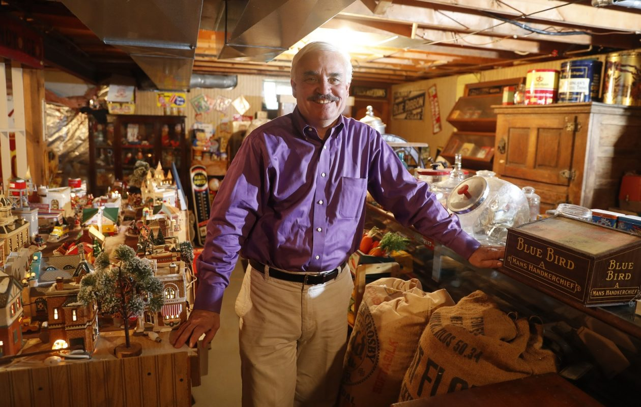 Mike Igoe, former TV reporter, has collected historic esoterica all his life, including barber signs, The Buffalo News honor boxes, cigarette posters, Cornflakes display cases and more. He had so much stuff in his basement that his neighbor actually built him a general store. (John Hickey/Buffalo News)