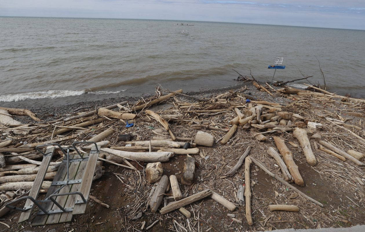 Debris rests along the shore of the beach at   Krull Park. High lake levels have eroded the shoreline in many Lake Ontario communities. (John Hickey/Buffalo News)