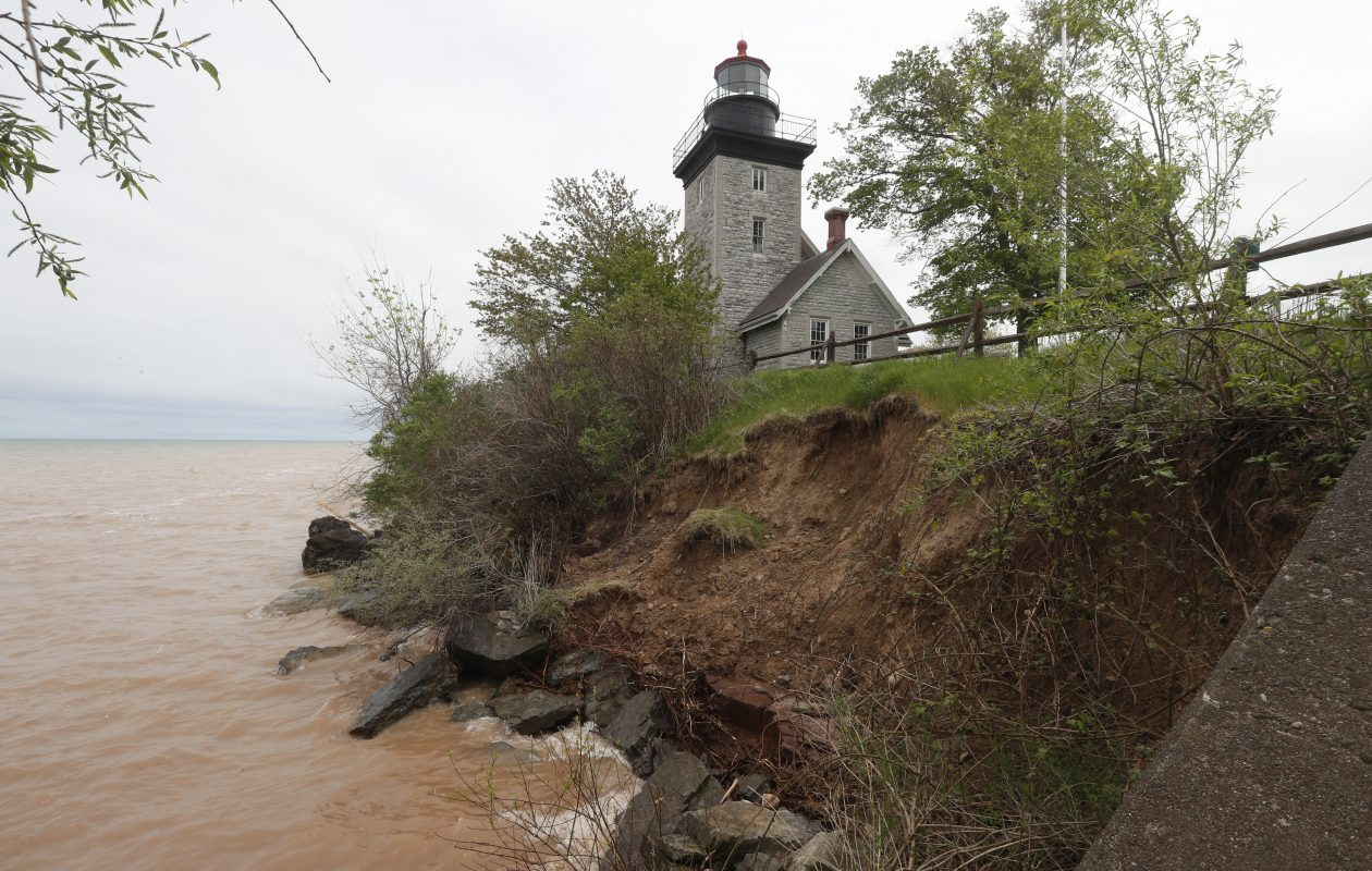 Lake Ontario erosion has eaten away land near the Thirty Mile Point Lighthouse at Golden Hill State Park.  But except for the Krull Park Beach and boat launches at Golden Hill and Fort Niagara state parks, attractions and services report they are open and welcoming visitors.  (John Hickey/Buffalo News)