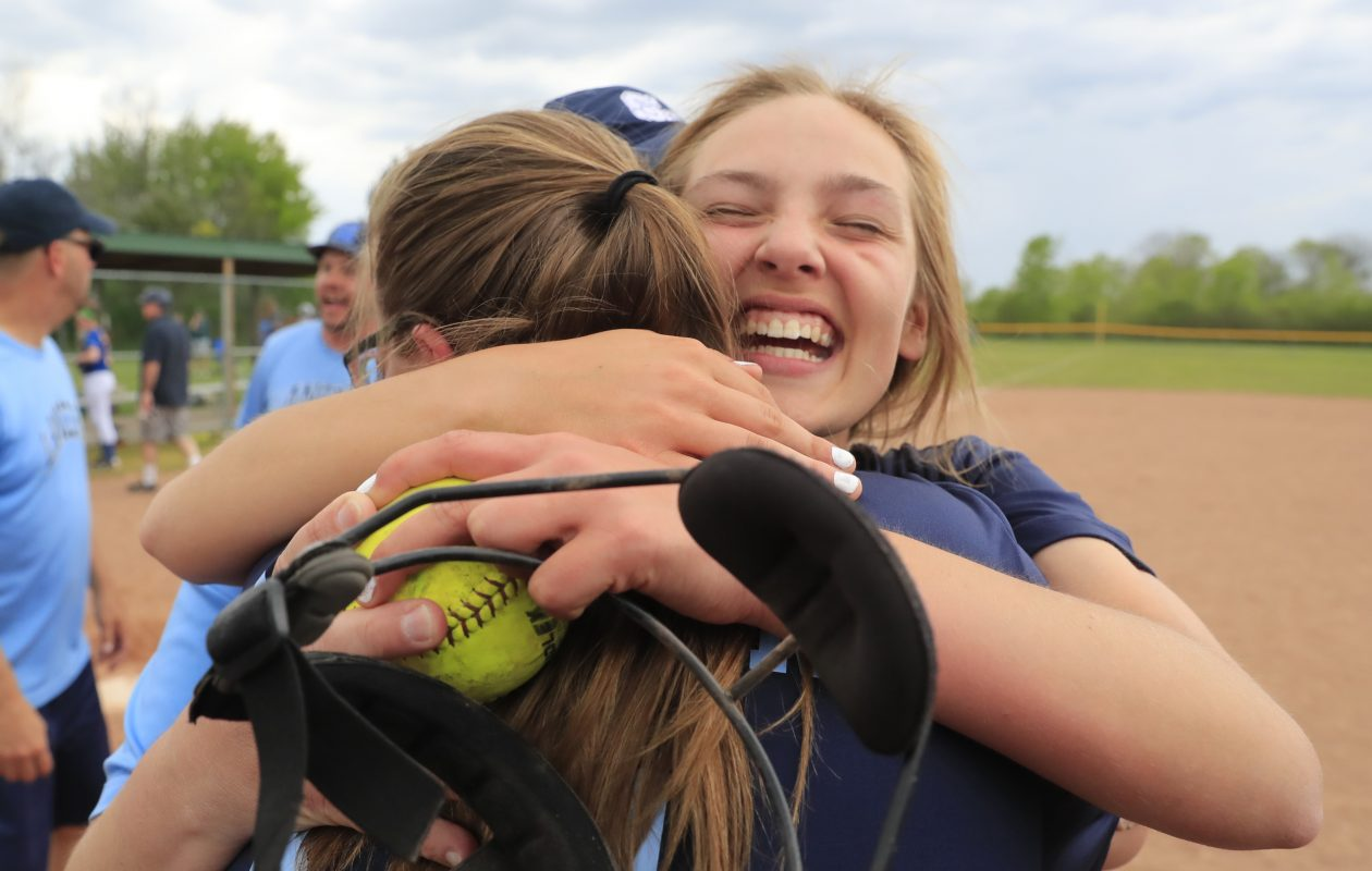 St. Mary's senior Erin Hufford hugs classmate Haley Wipperman after defeating Mount Mercy for the Monsignor Martin softball championship at Sunshine Park on Wednesday. (Harry Scull Jr./Buffalo News)