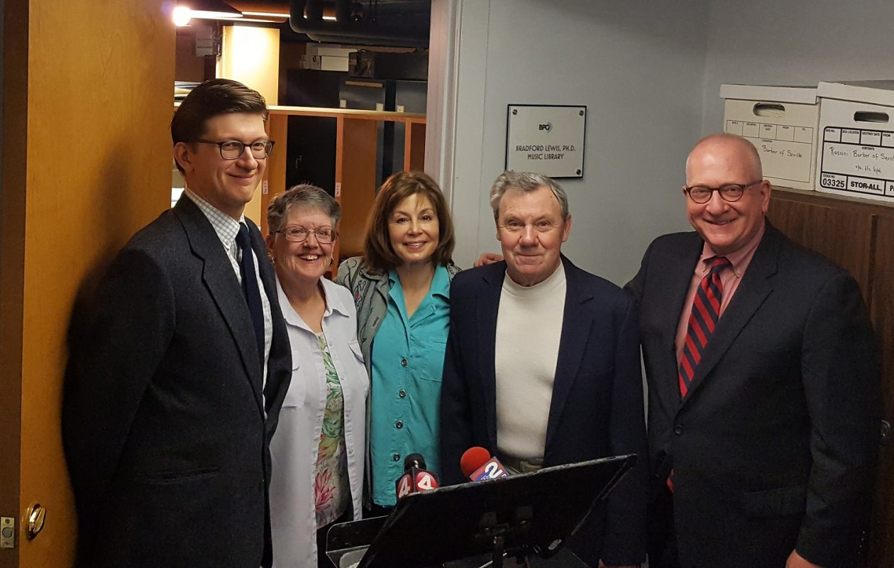 Left to right: Travis Hendra, associate music librarian; Pat Kimball, principal music librarian; JoAnn Falletta, BPO music director; Bradford Lewis, PhD; Daniel Hart, BPO executive director. Behind them is the music library, now named after Dr. Lewis in recognition of his substantial gift to the orchestra's Crescendo Campaign. (Photo via BPO)