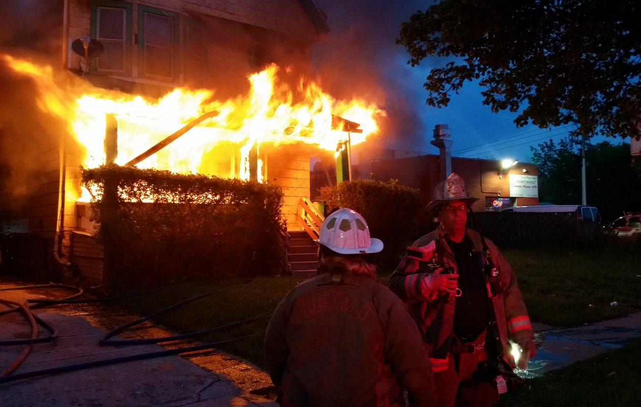 Buffalo firefighters on the scene as flames engulf a home on Kensington Avenue. (David F. Kazmierczak/Special to The News)