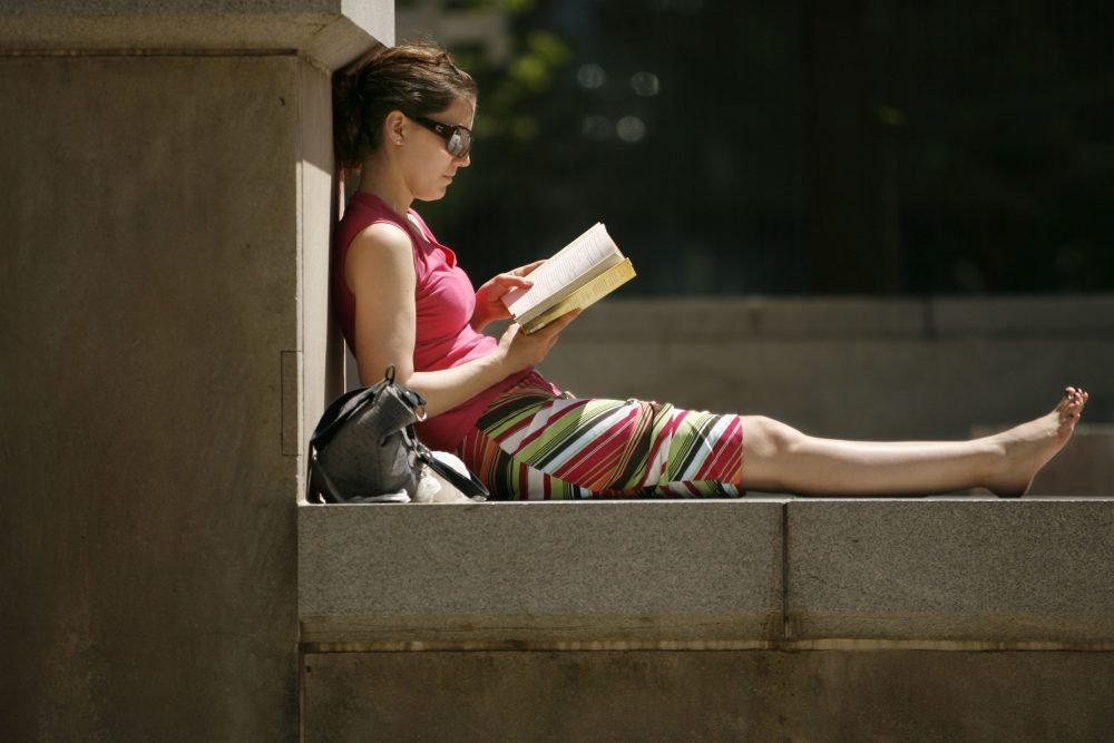 Soaking in the sun on Main Street across from Fountain Plaza. (Derek Gee/Buffalo News file photo)