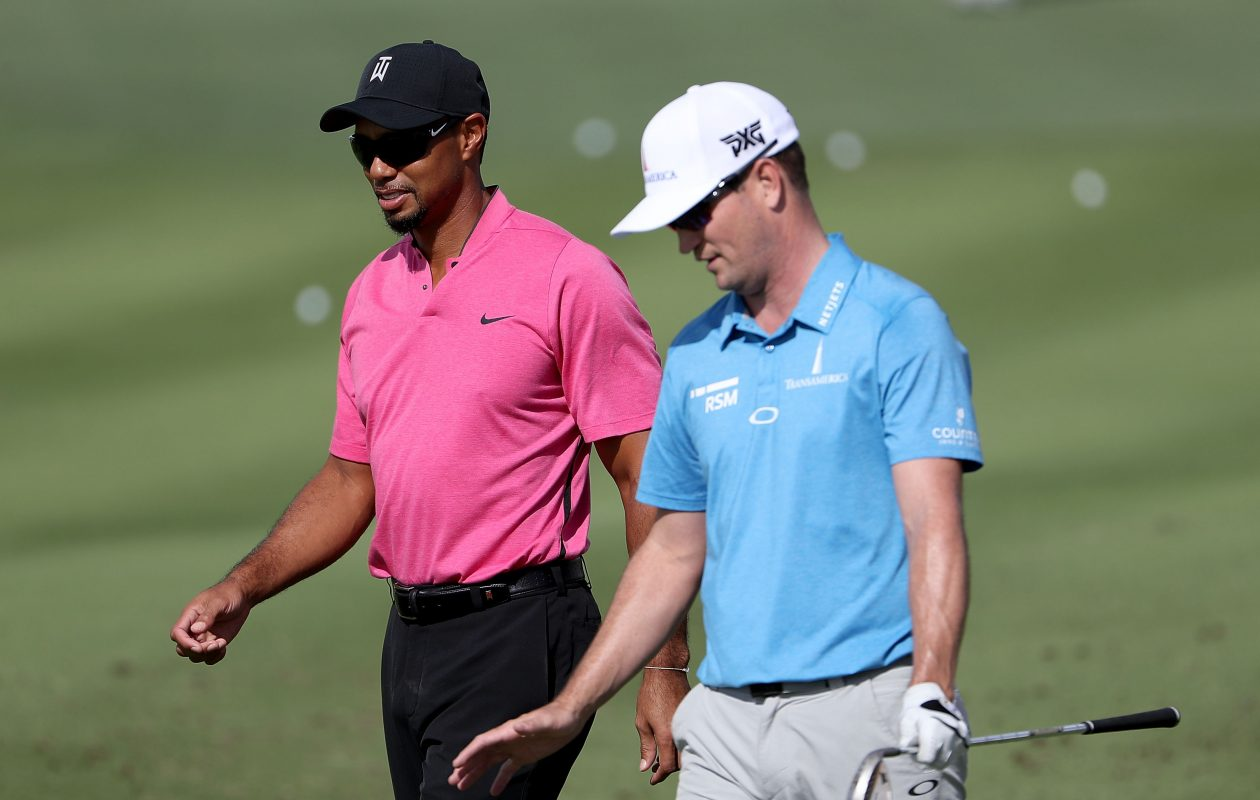 Tiger Woods talks with Zach Johnson at a practice for the Hero World Challenge, the last tournament Woods played, in November 2016. (Getty Images)