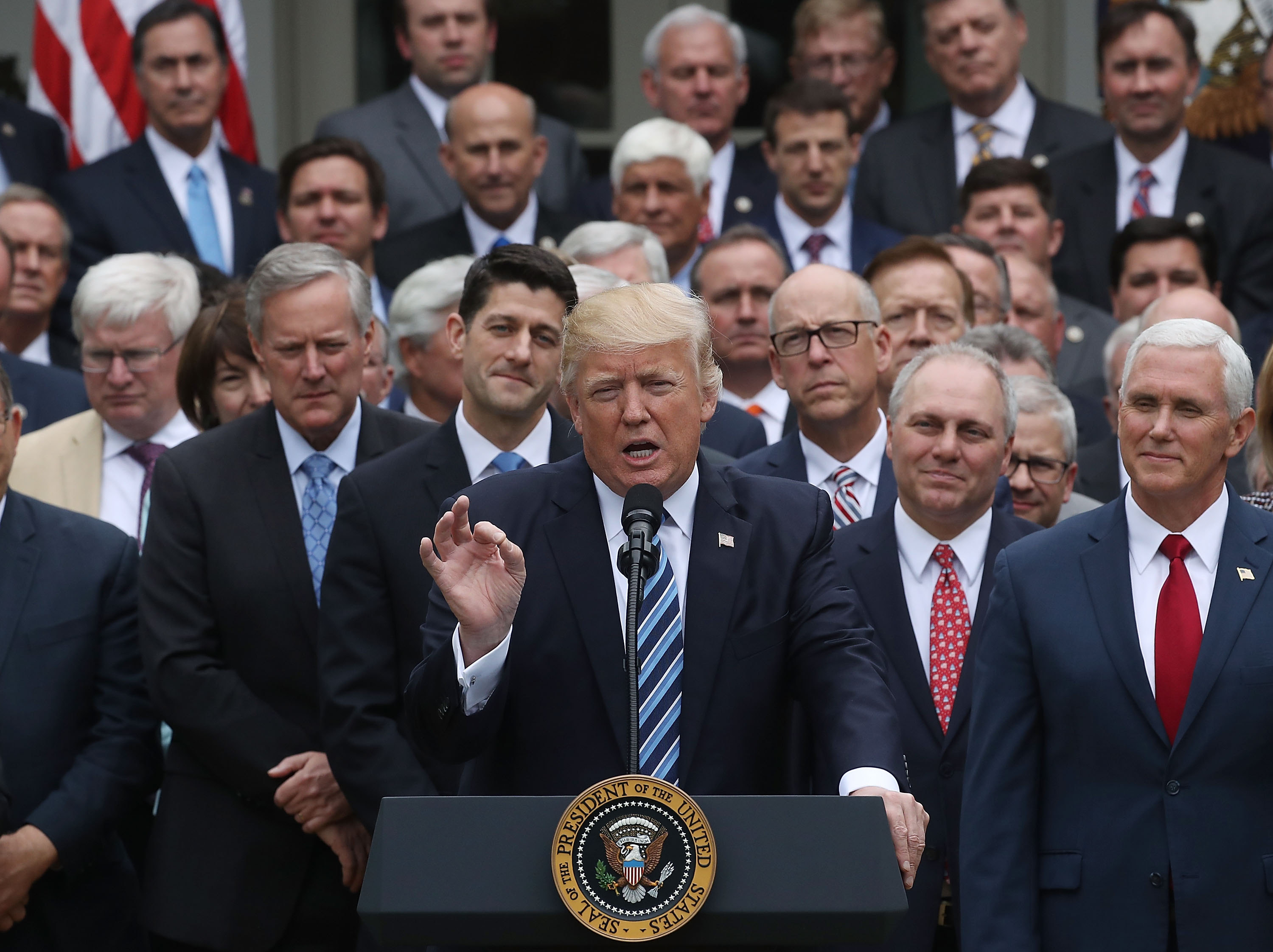 President Donald Trump speaks while flanked by House Republicans after they passed legislation aimed at repealing and replacing ObamaCare, during an event in the Rose Garden at the White House, on May 4, 2017 in Washington, DC. The House bill would still need to pass the Senate before being signed into law. (Getty Images)