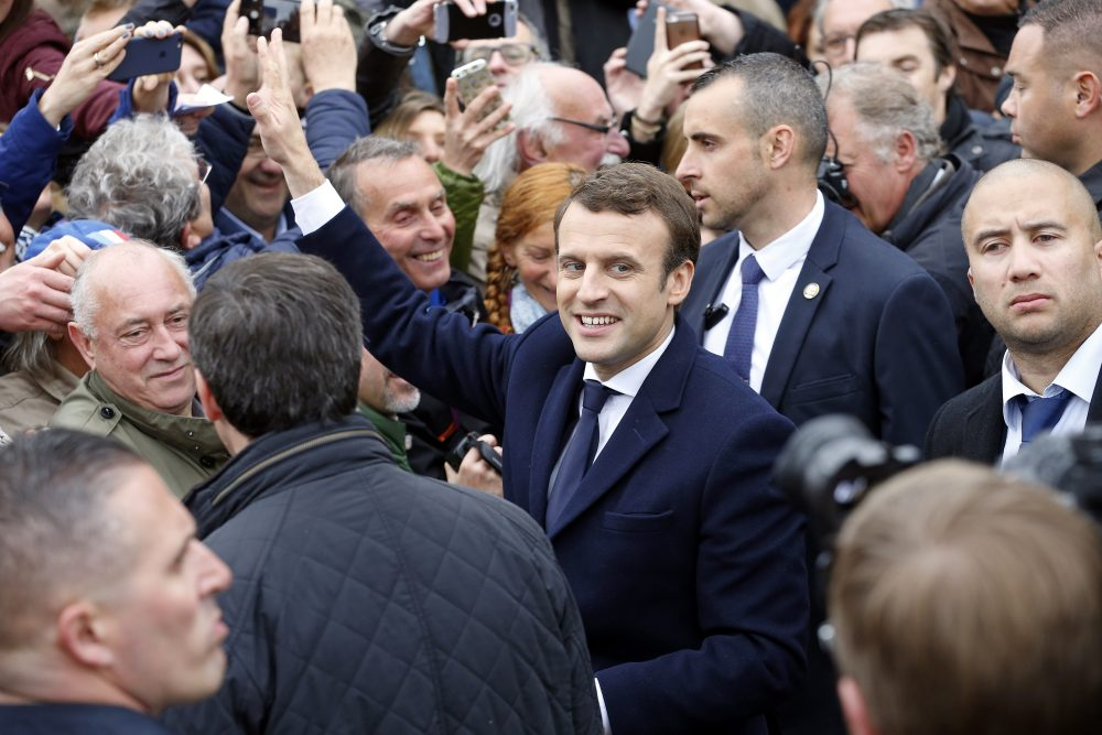 French presidential election candidate for the 'En Marche!' (Onwards!) political movement, Emmanuel Macron, meets his supporters as he leaves the polling station of the town hall after casting his vote in the second round of the French presidential elections on Sunday, May 7, 2017. in Le Touquet-Paris-Plage, France.  (Photo by Thierry Chesnot/Getty Images)