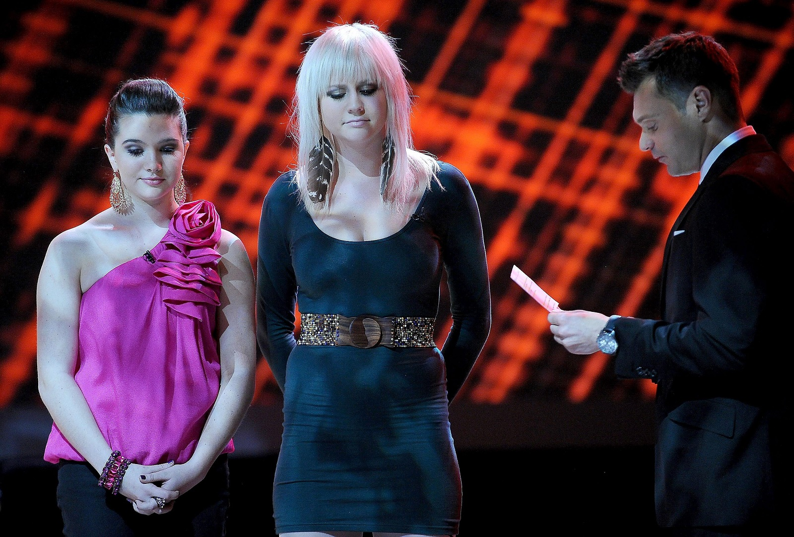 Aontestants Katie Stevens, left, Lilly Scott and host Ryan Seacrest, right, during American Idol Season 9 in 2010, in Los Angeles. The show is coming back to TV in 2018, this time on ABC. (Photo by Michael Becker/PictureGroup for FOX)