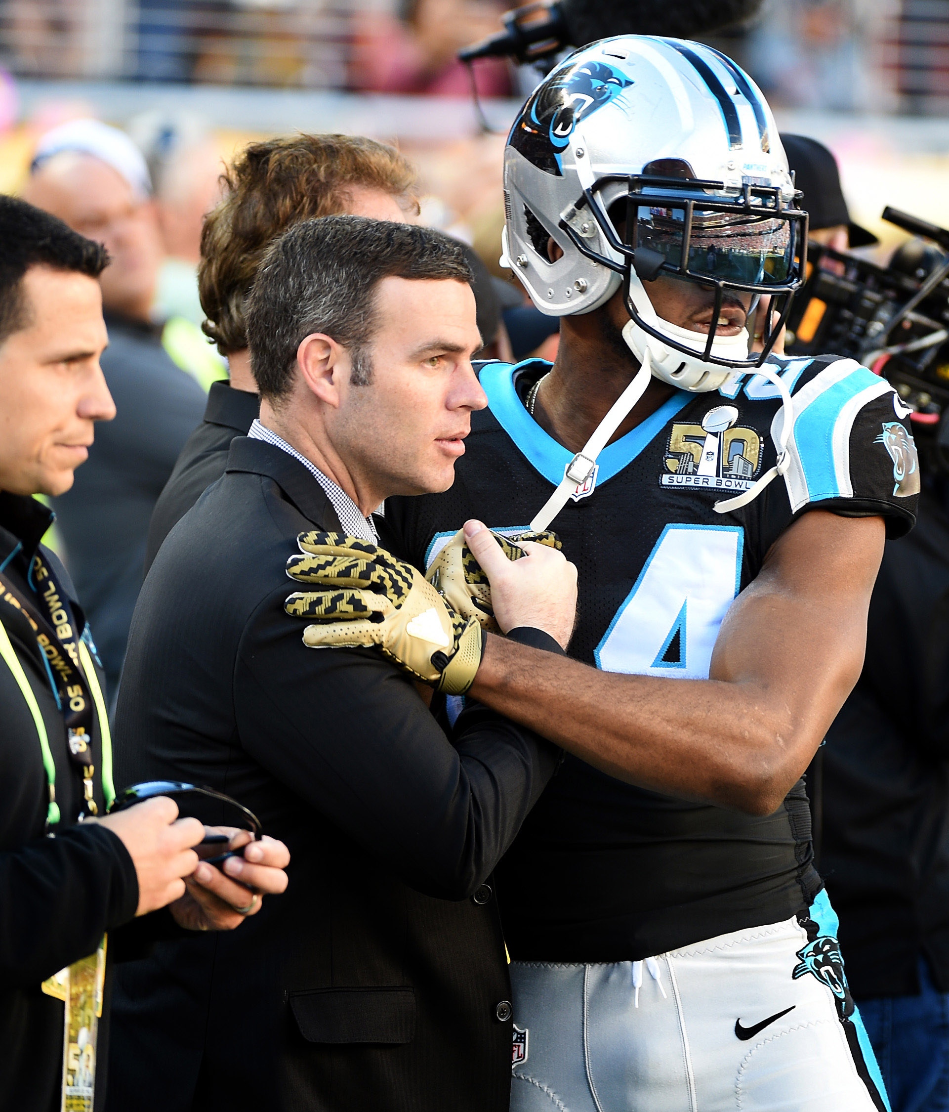 Carolina Panthers assistant general manager Brandon Beane, left, and cornerback Josh Norman, right, greet one another prior to action in Super Bowl 50. (Charlotte Observer)