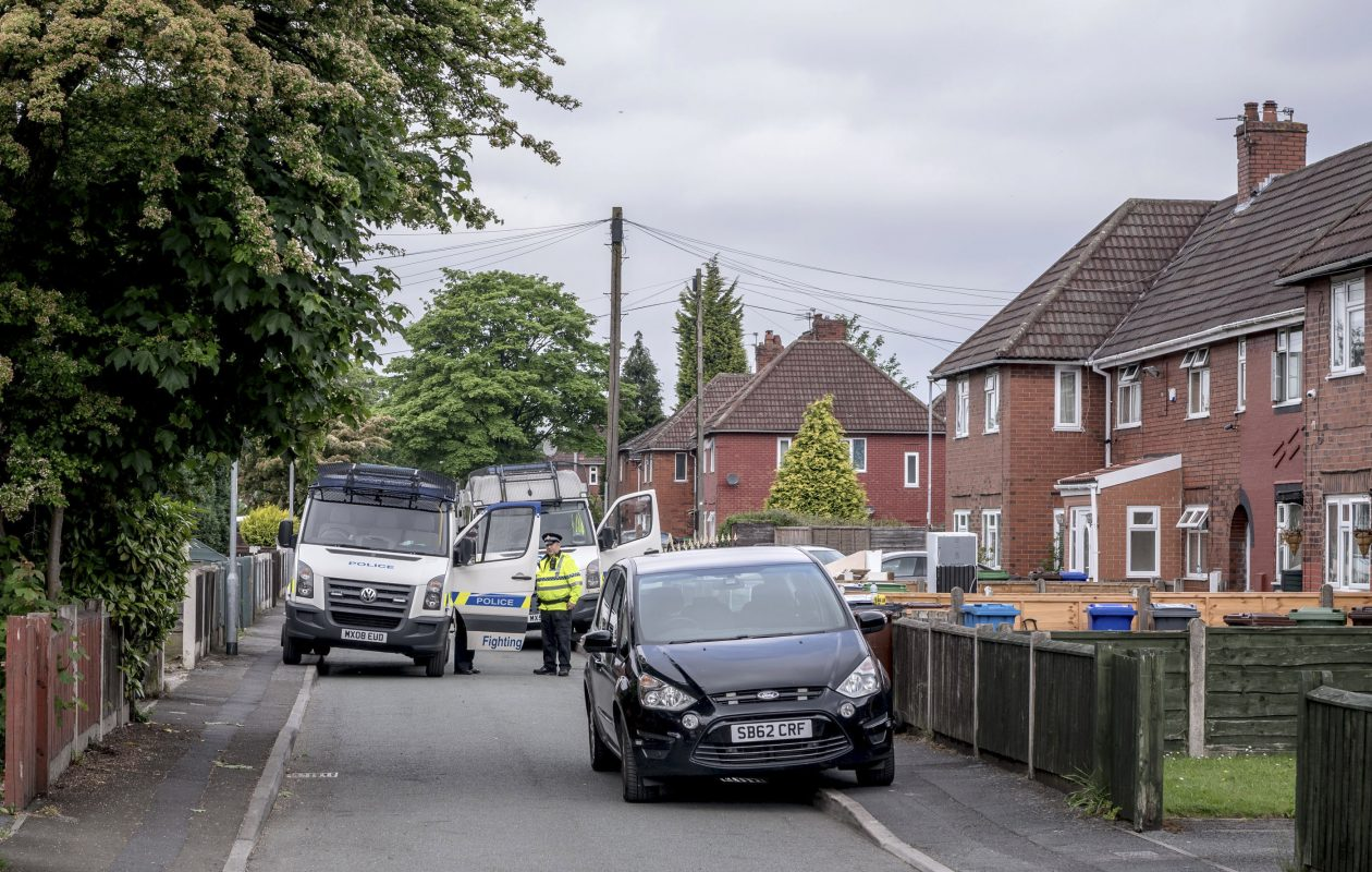Police officers blocked the road where the Abedi family lived in a suburb of  Manchester, England, May 24, 2017. On Monday night, Salman Abedi, 22, set off a crude improvised bomb as fans were leaving a concert by the American singer Ariana Grande. The explosion killed 22 people and wounded dozens of others. (Andrew Testa/The New York Times)