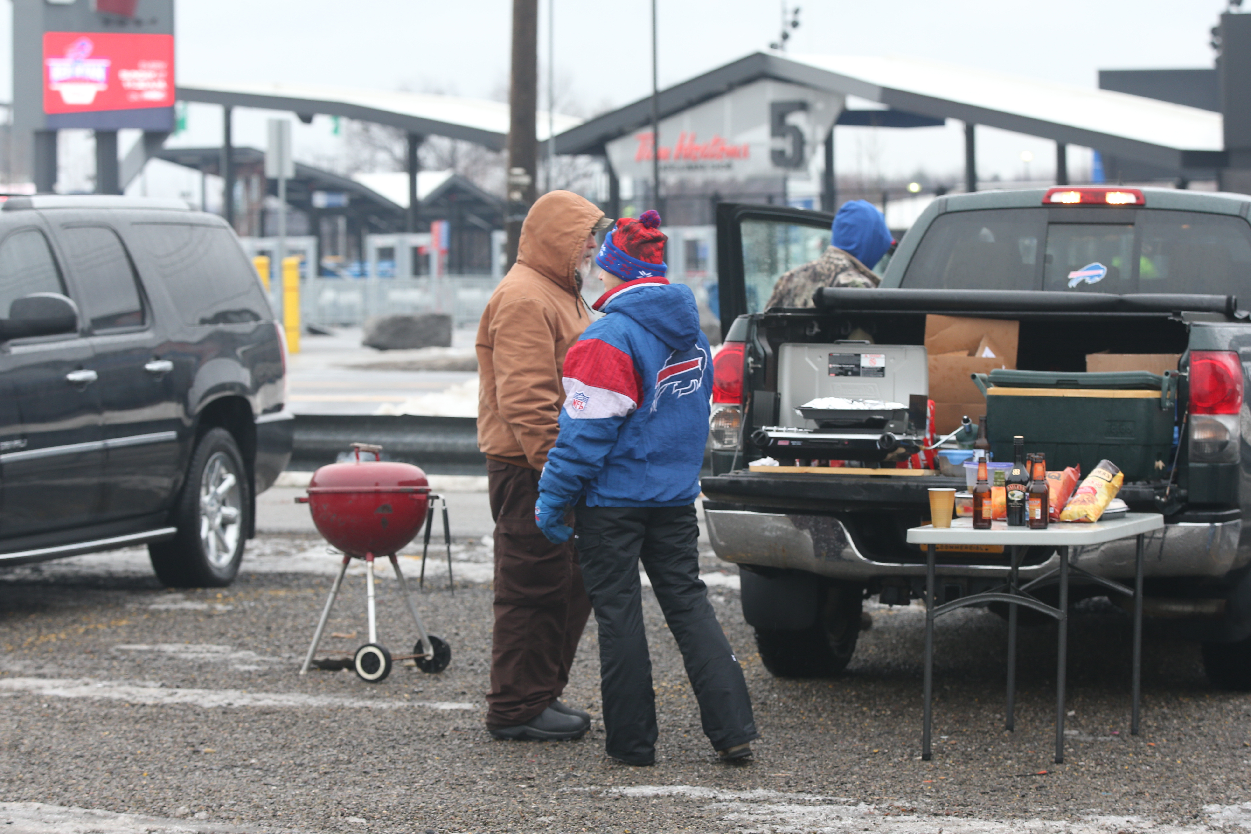 Buffalo Bills fans party in the parking lot before the game at New Era Field Orchard Park N.Y. on Saturday, Dec. 24, 2016.  (James P. McCoy/Buffalo News)