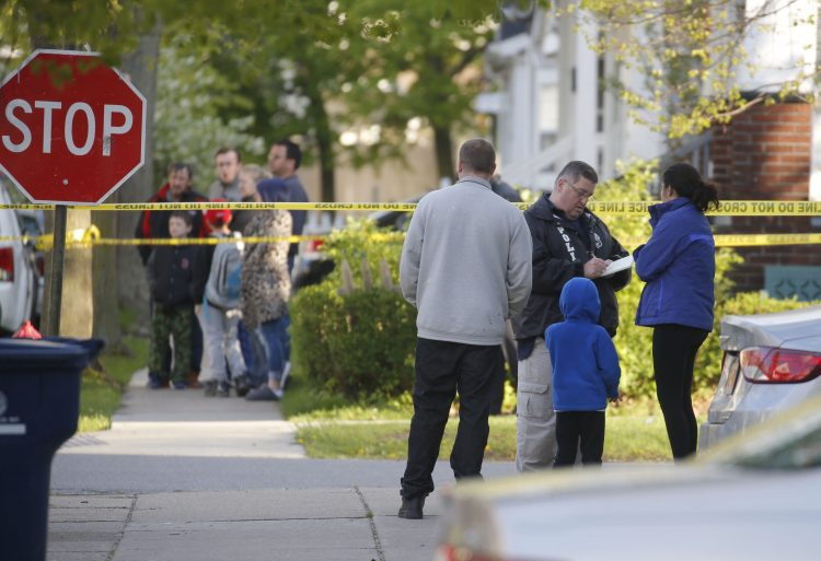 Detectives ask questions following a shooting at  Garfield Street and Hartman Place, where a Buffalo police officer was injured in a shooting and the suspect was shot dead on Sunday, May 7, 2017. (Robert Kirkham/Buffalo News)