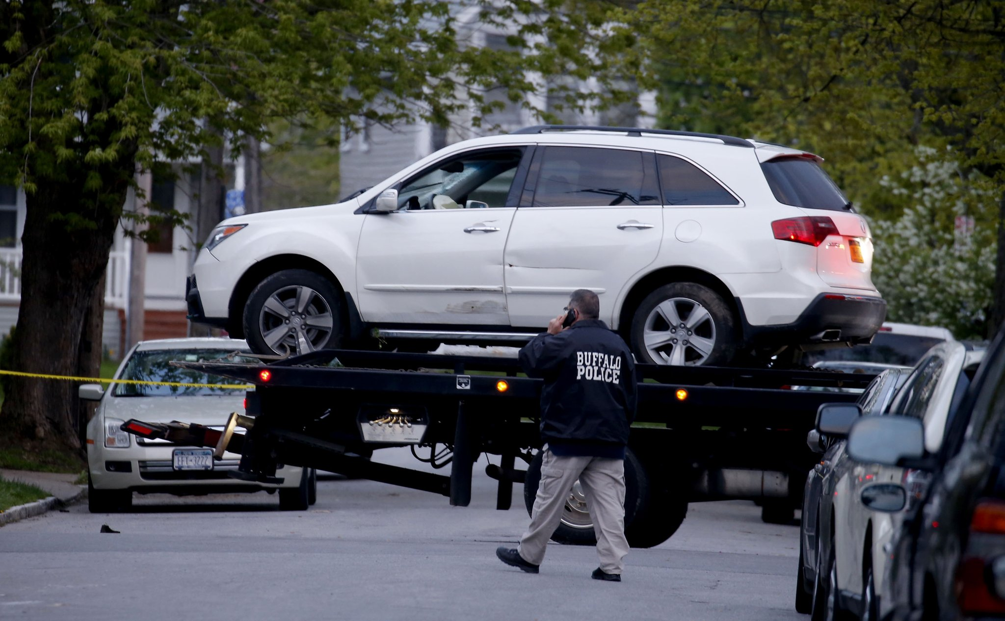 A deflated air bag can be seen in the SUV that Jose Herndandez-Rossy was driving is towed away Sunday. (Robert Kirkham/Buffalo News)