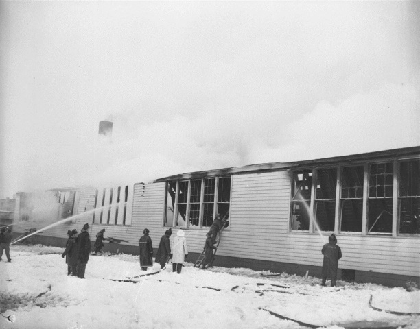 Firefighters battle the blaze at the Cleveland Hill School annex that eventually took 15 lives. (News file photo)