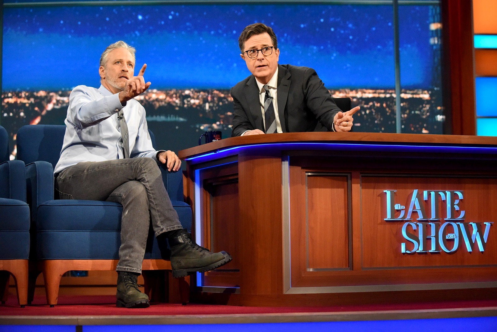 Stephen Colbert, here with Jon Stewart, is seeing his ratings rise along with his profile. (Scott Kowalchyk, CBS)
