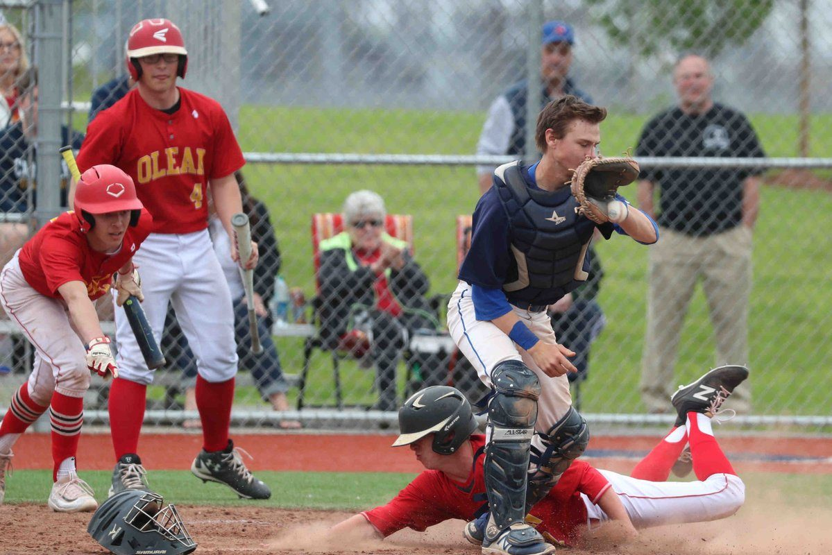 Olean's Nick Crandall slides home with a run during the Huskies' triumph in the overall Section VI Class A final over Williamsville South at Niagara Falls High School. (James P. McCoy/Buffalo News)