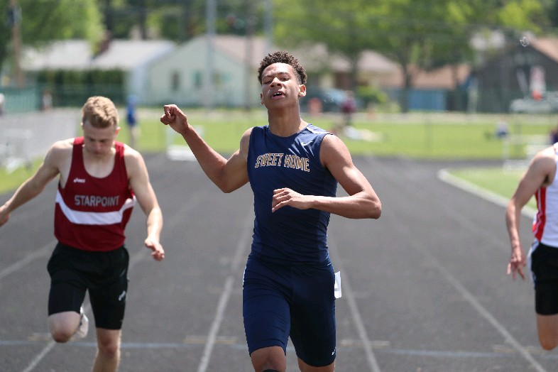 Nathaniel Davis of Sweet Home was unbeatable in Saturday's ECIC track and field meet in Hamburg. (Photo by James P. McCoy / Buffalo News)