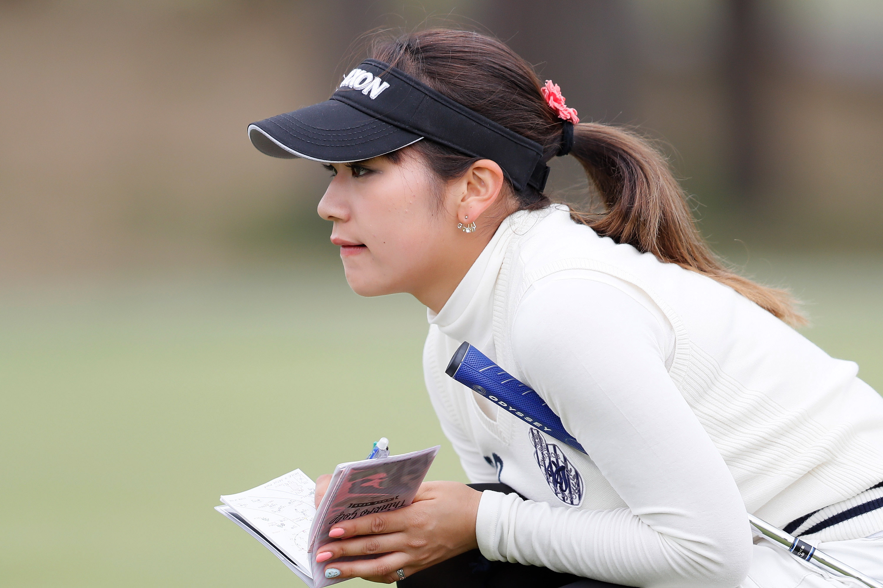 Ayano Yasuda reads a putt. The use of detailed green-reading books has become a golf controversy. (Ken Ishii/Getty Images)