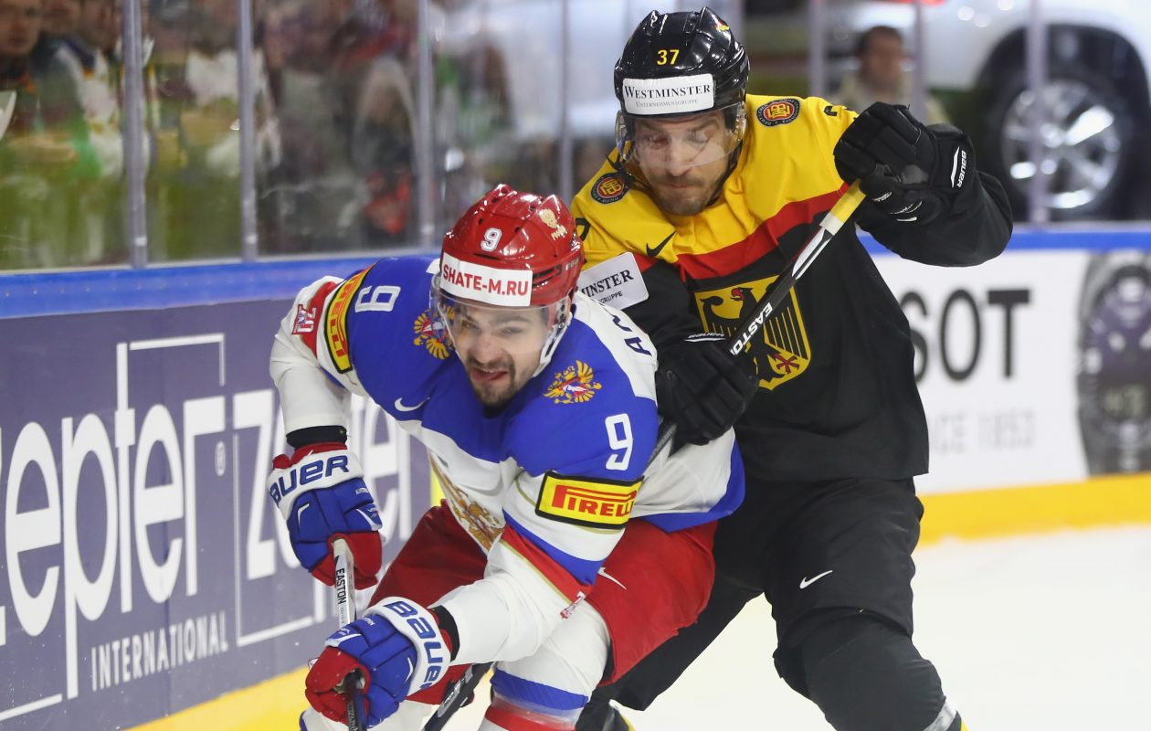 Russia's Viktor Antipin, left, had four assists in 10 games at the world championships, including a meeting with Patrick Reimer and Germany. (Getty Images)