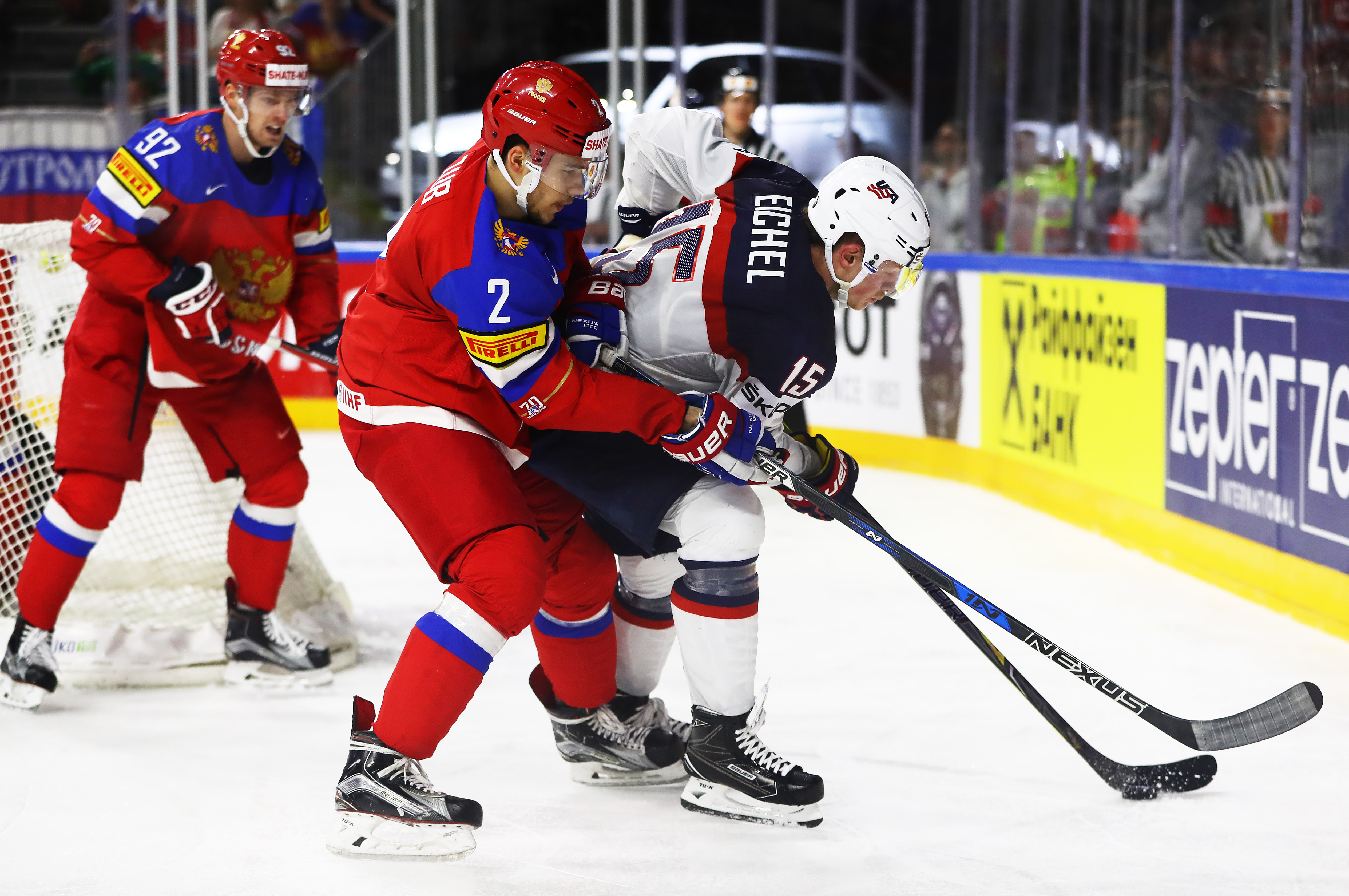 Jack Eichel holds off Artyom Zub of Russia during the United States' victory Tuesday. (Getty Images)