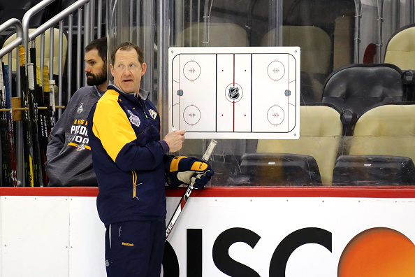 Phil Housley helps direct Predators practice prior to Game One (Getty Images).