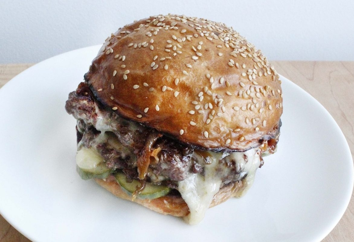 From The Grange Community Kitchen's Brad Rowell: brisket and house-smoked Weiss Farm shiitake burger with aged cheddar, caramelized onions, and horseradish whole grain mustard aioli on a house-made sesame potato bun.