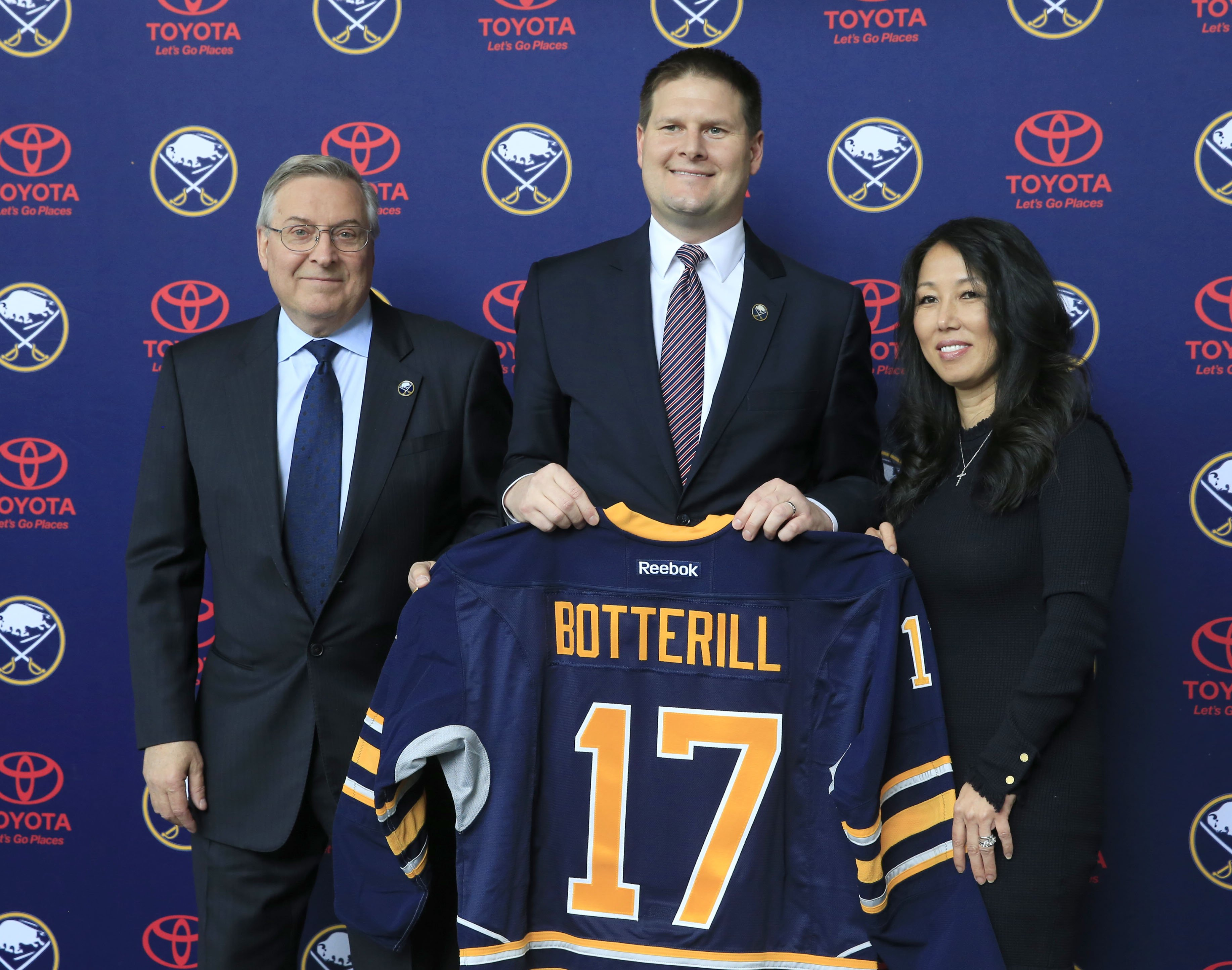 Terry Pegula, left, and his wife, Kim, welcome General Manager Jason Botterill to Buffalo. (Harry Scull Jr./Buffalo News)